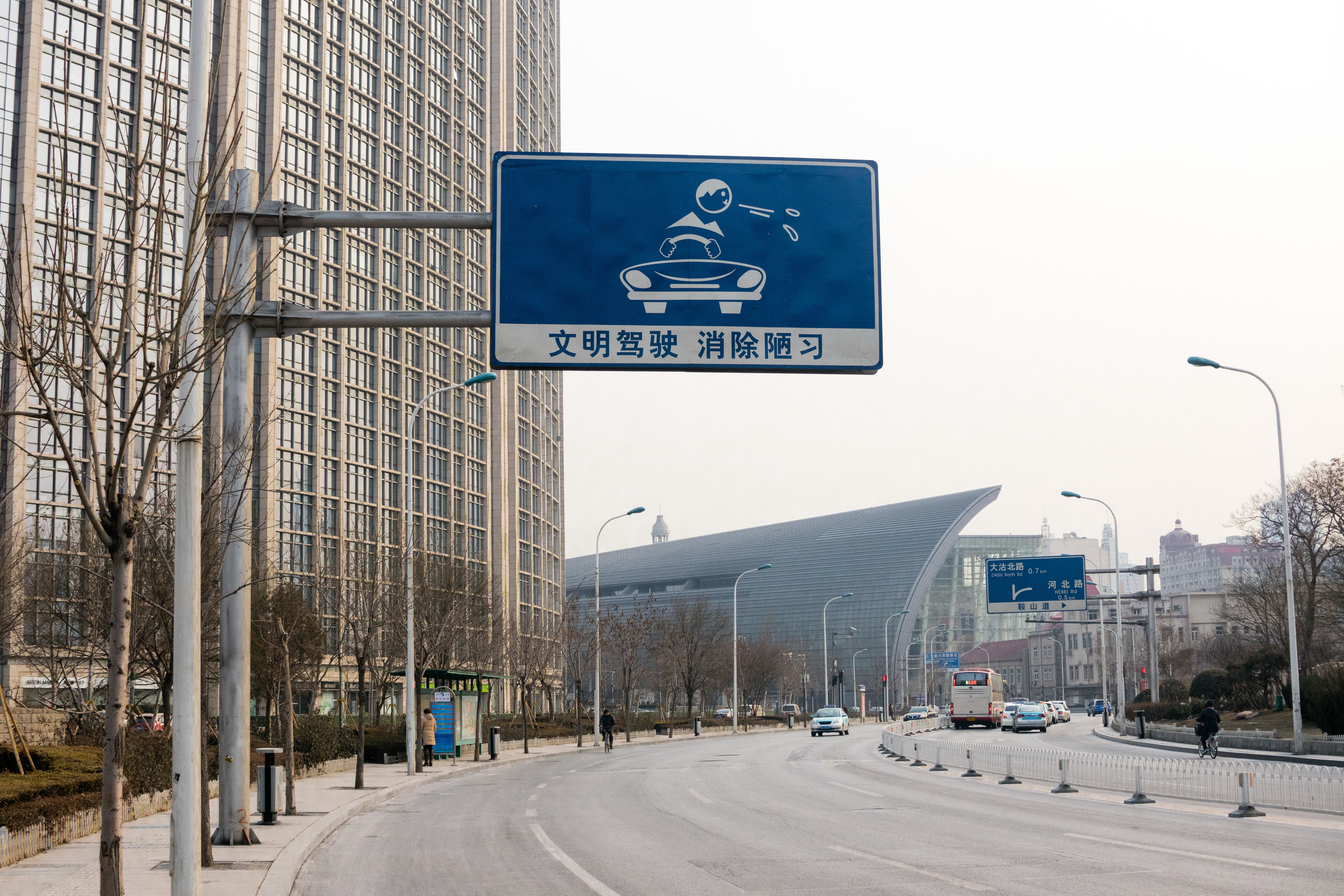 A lot of people spit in China. The sign says be curtious to other drivers. So don't spit while driving.