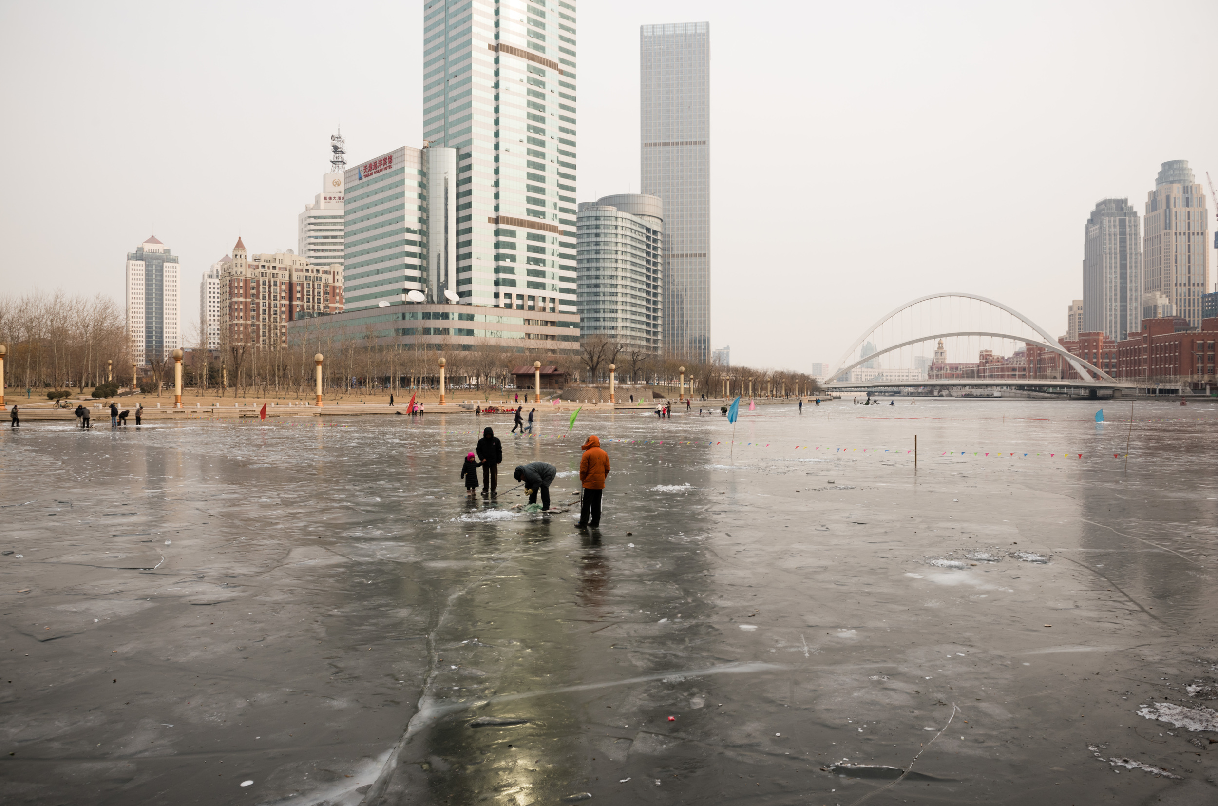Locals fishing on the frozen Hai River