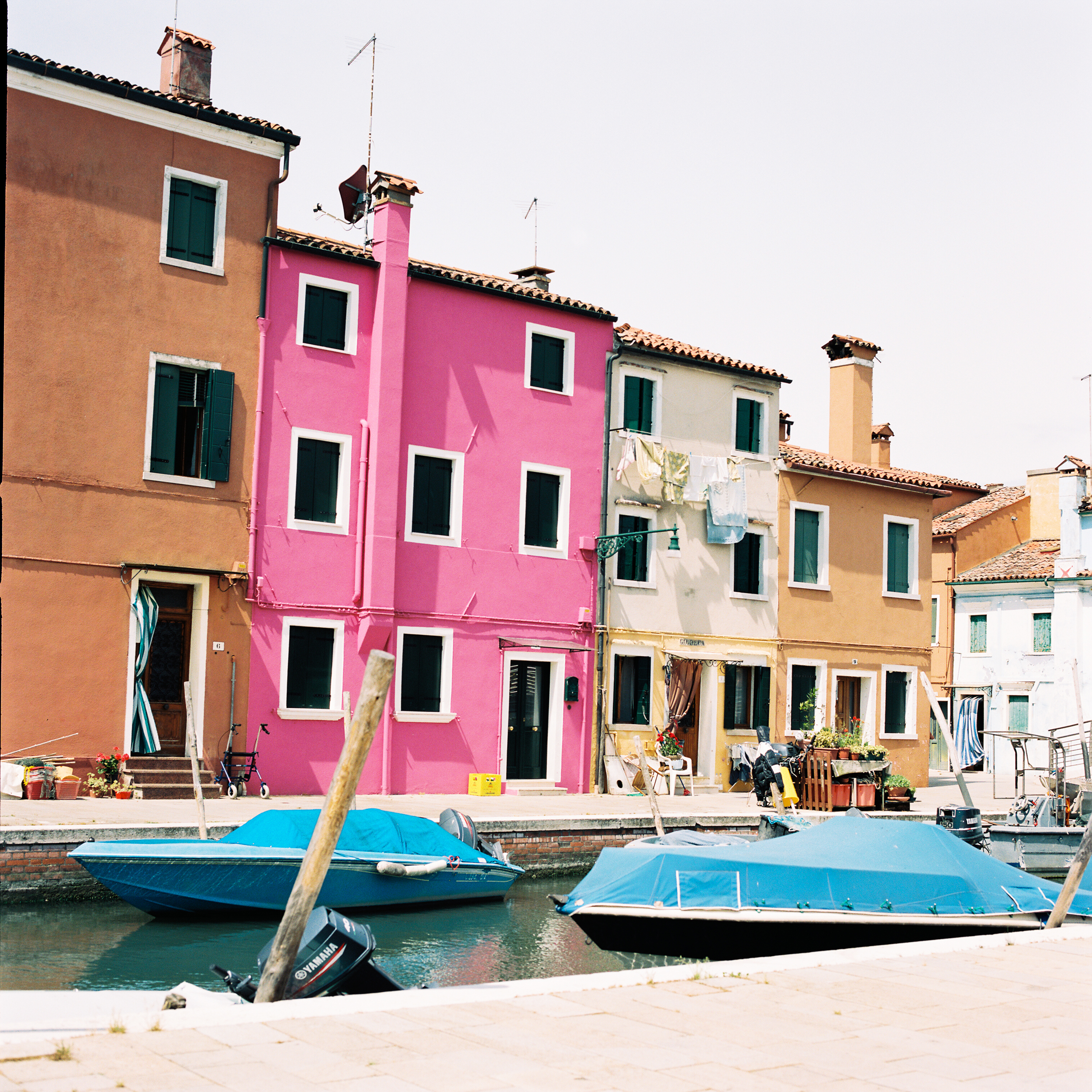 I could've hung around Burano alllll day long. The colored homes definitely lived up to all the hype.  We snacked on some delicious cherries and grapes that we purchased from the prettiest little fruit market.