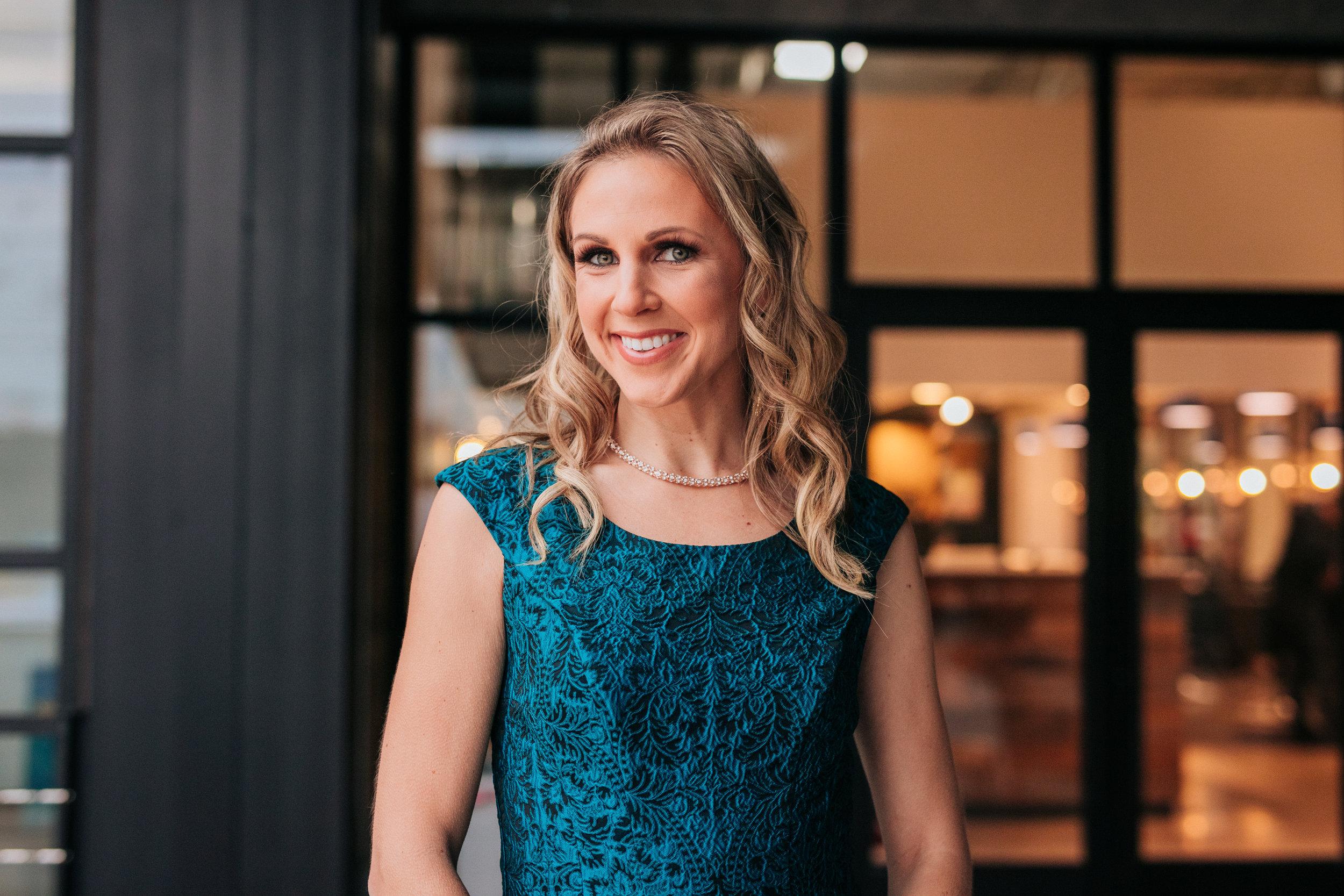 Stacy Tuschl headshot on The Higgins Creative