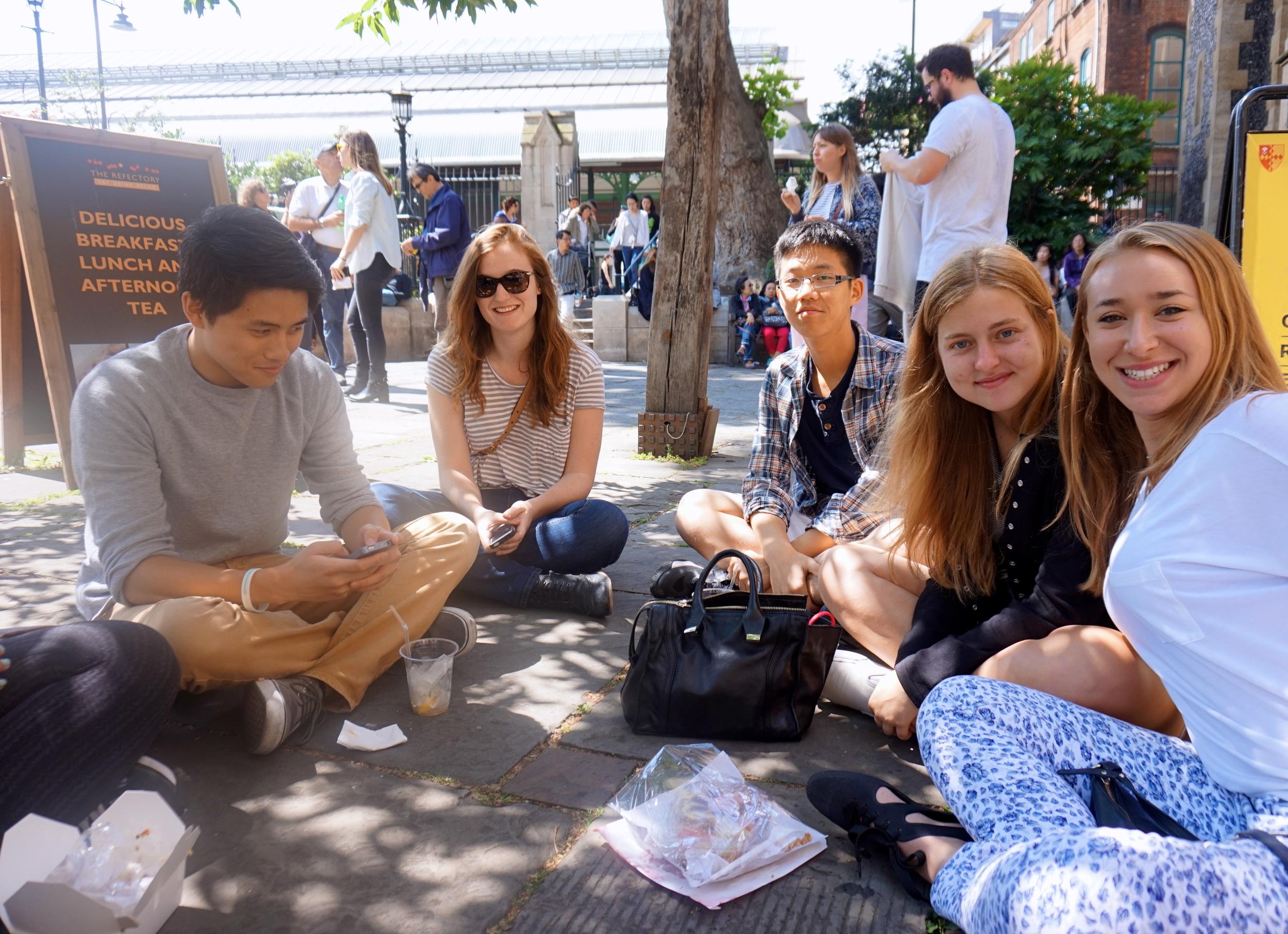 The gang lunching in the church courtyard.