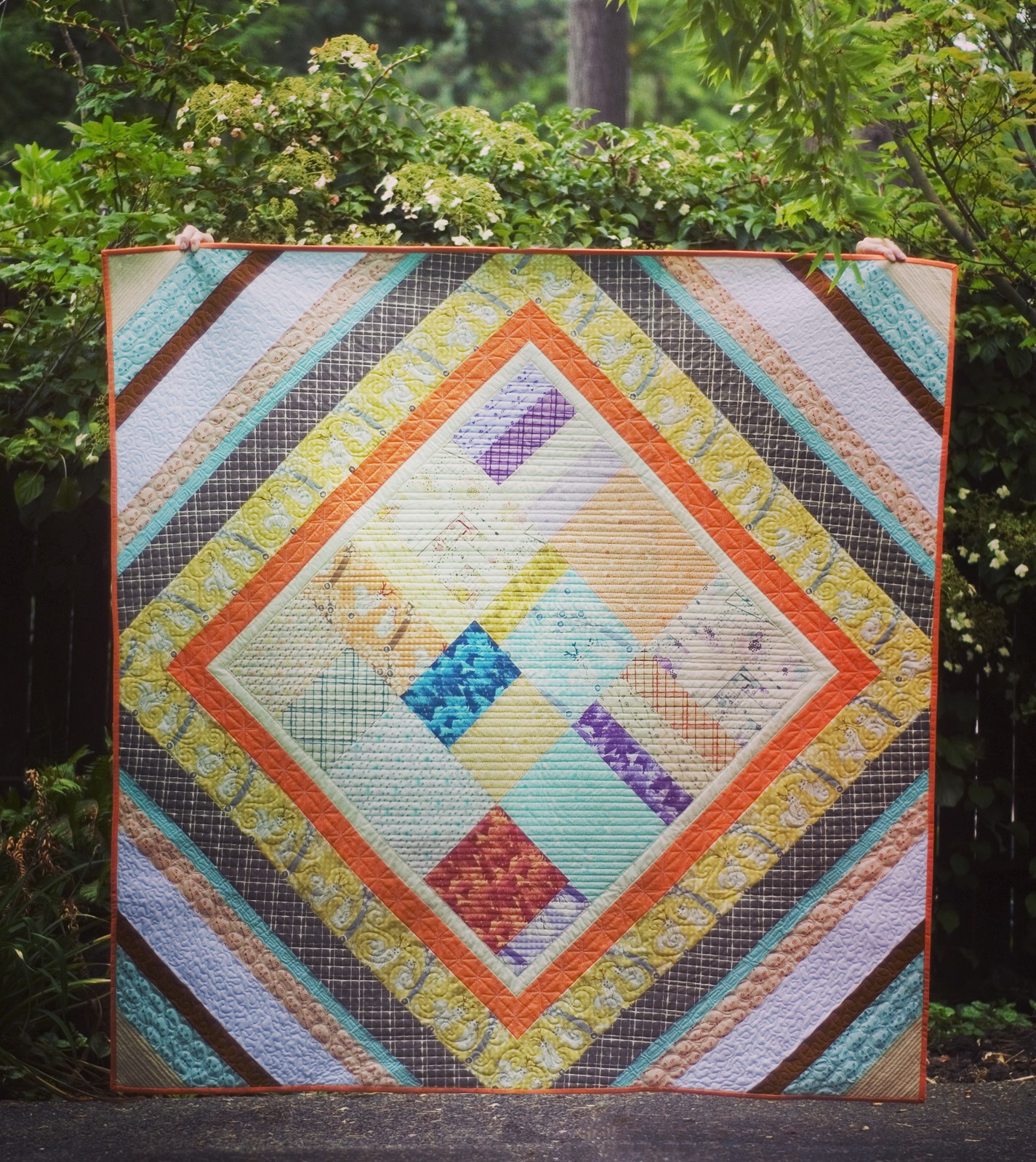 The Boho Quilt features a quick pieced center from fat eighths, set on point with multiple strip borders.  #thebohoquilt