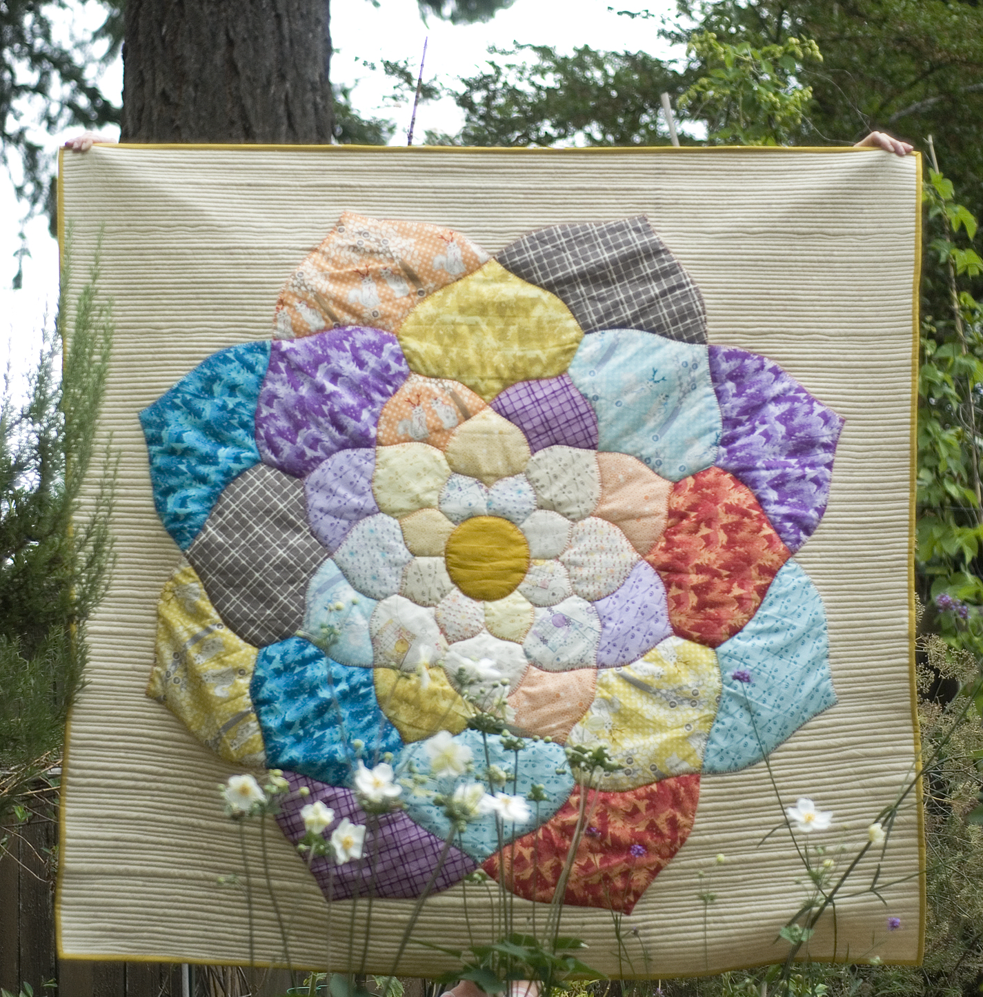 The Mandala Quilt features a very quickly cut and glue-basted mandala center, raw edge appliqued to the background.  #themandalaquilt