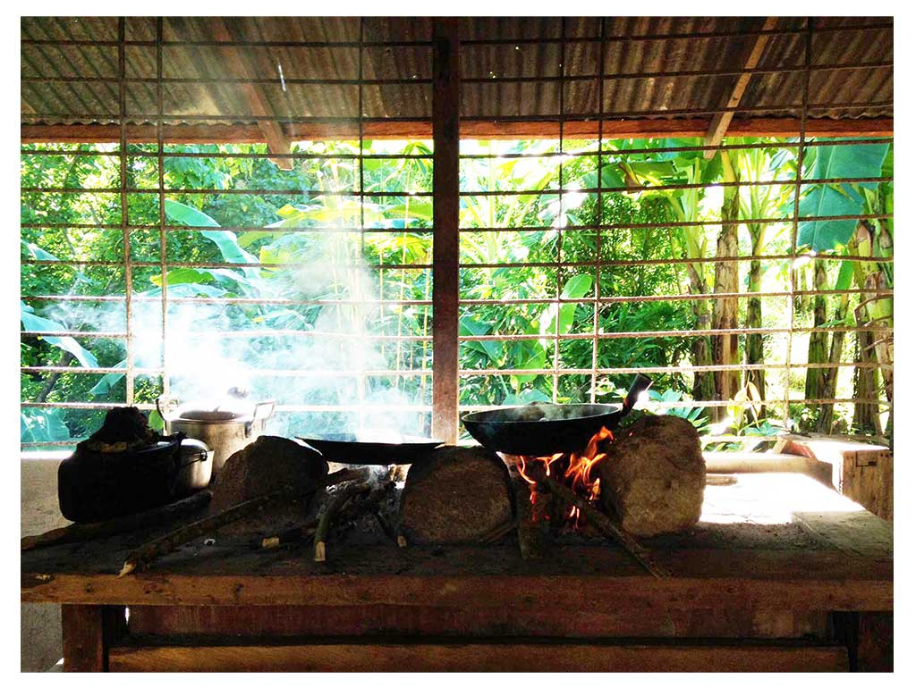 "Cooking Filipino style on the ""abuhan"" in Patis' farm."