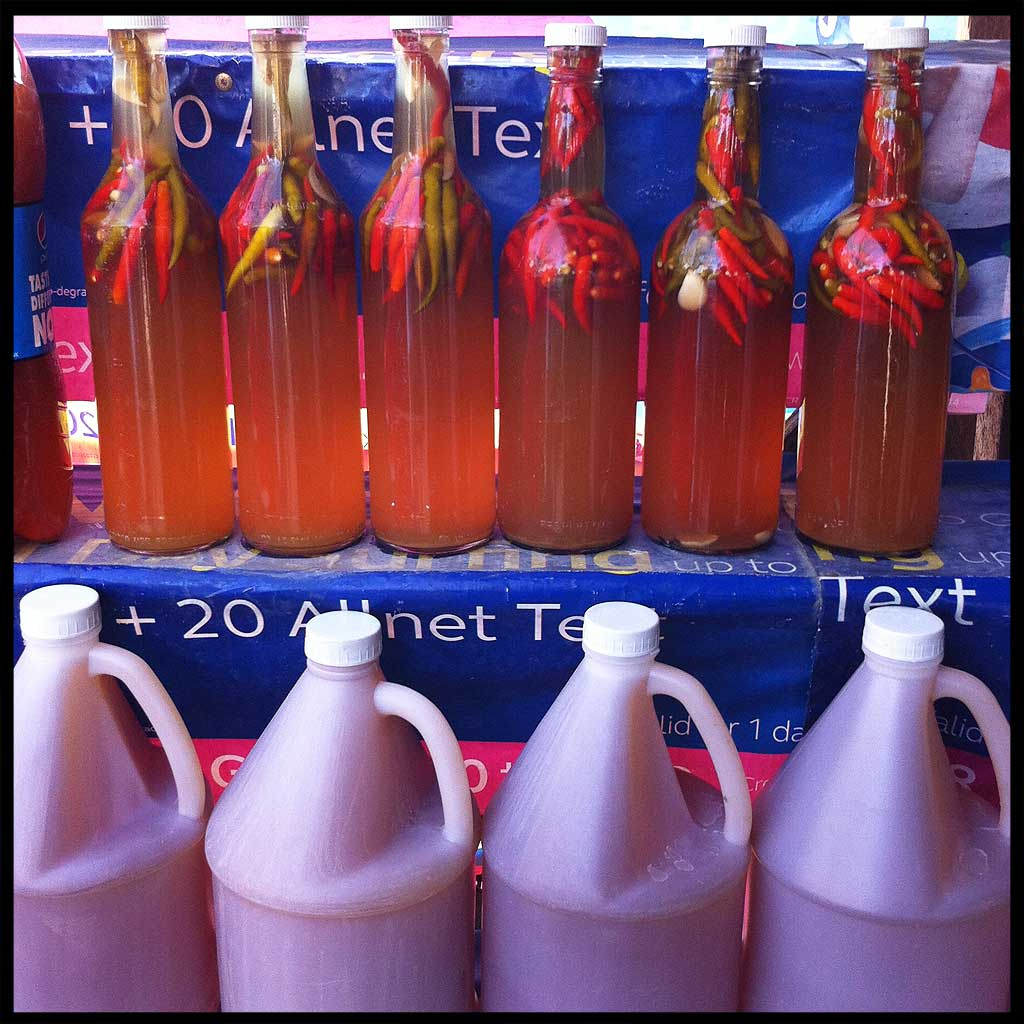 Bottles and jugs of different types of vinegar are found along the highway in Binalonan, Pangasinan.