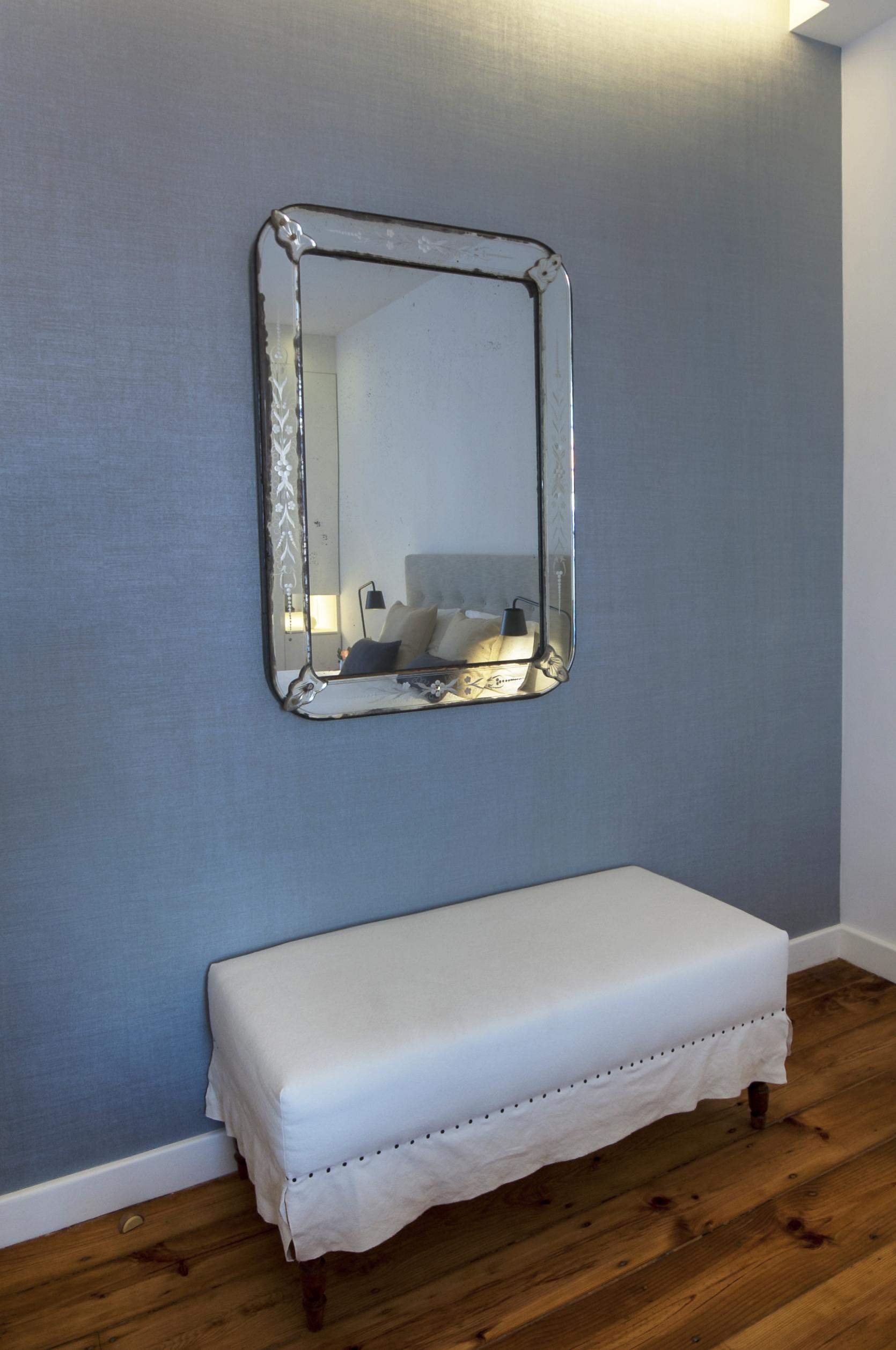 13 Bedroom 1 detail an original antique Venetian mirror.jpg