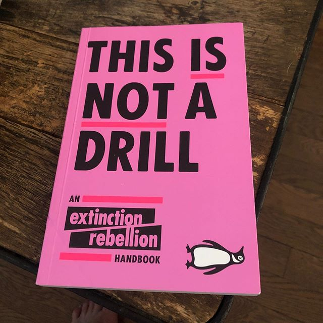 Currently reading.  #sleepwalkingtowardstheedgeofacliff #extinctionrebellion #climatebreakdown