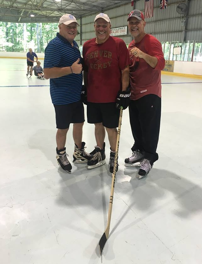 The Can-Ice Team: Danny Gare, and Mike McGraw with Stanley Cup Champion, Ken Daneyko, on a full sized Can-Ice rink.