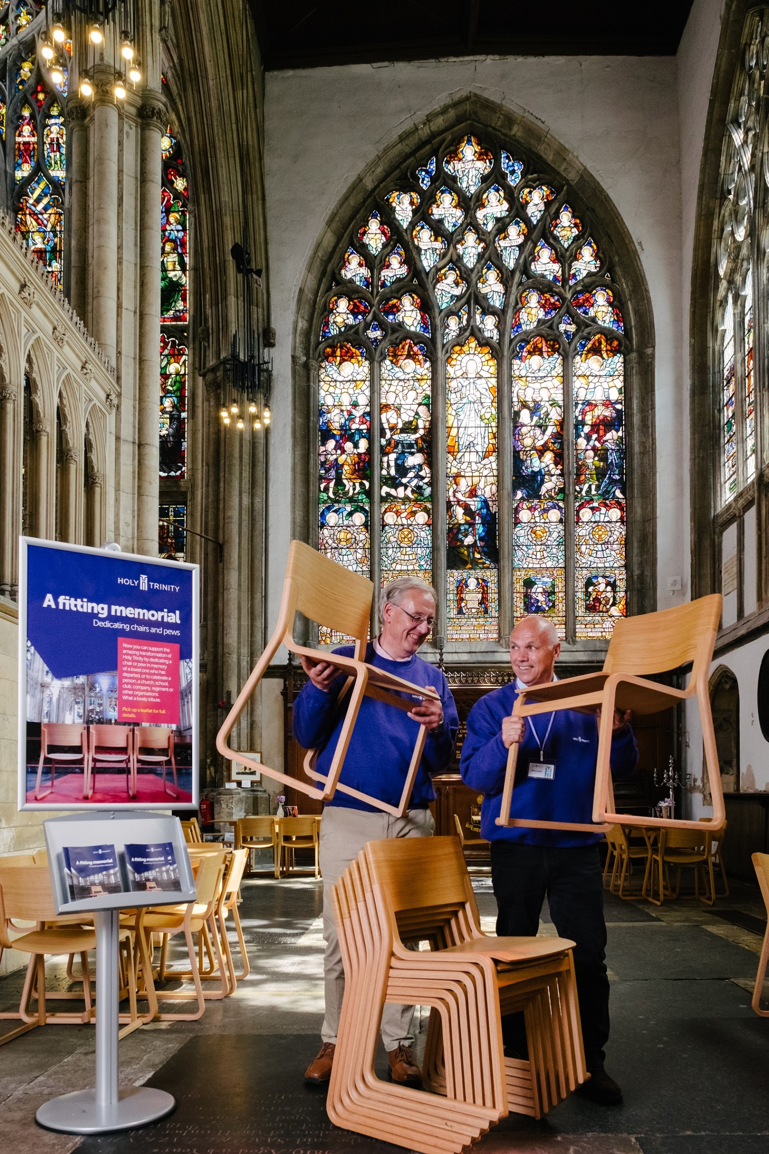 Volunteer welcomers Ray Taylor, left, and John Lawson will be encouraging visitors to Holy Trinity Church to dedicate a chair to support the transformation of the 700-year-old church.