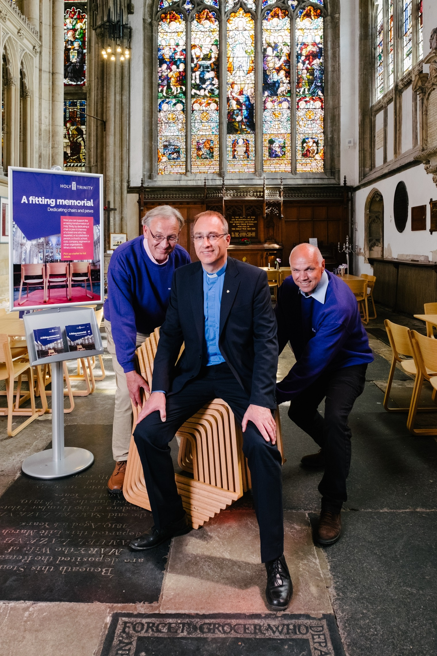 Volunteers Ray Taylor, left, and John Lawson help Vicar Neal Barnes to launch the appeal for supporters of Holy Trinity to dedicate new chairs within the church.
