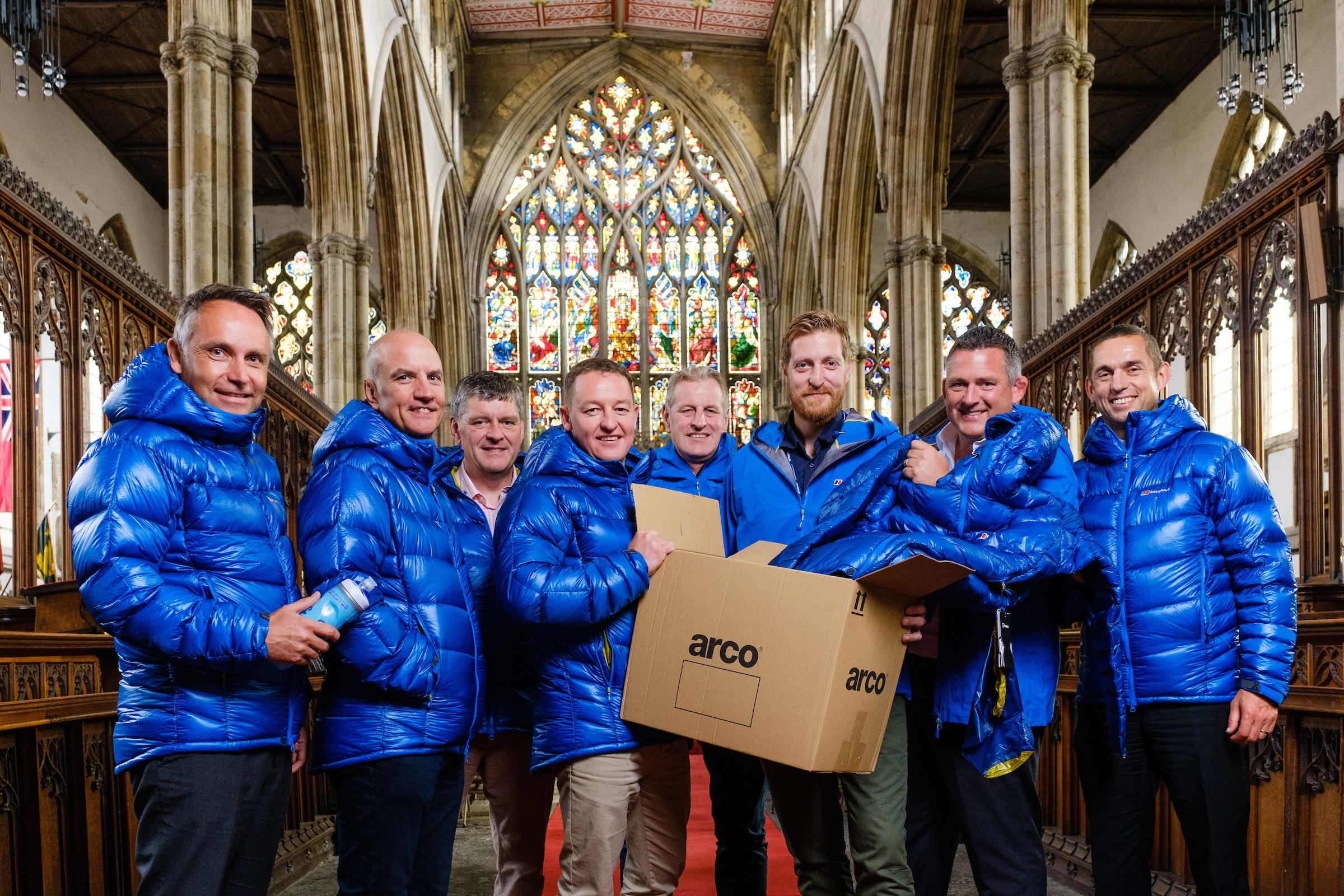 Summit Club sponsor representatives Neil Riseham (Arco), centre left, and Andy Parkinson (Spencer Group) with some of the donated Arco clothing, joined by Kilimanjaro climb team members, from left, Nick Ward (Alan Wood and Partners), Jonathan Leafe (Strawberry), Brian Gilliland (Holy Trinity), Andy Allenby (Allenby Commercial), Nic Marshall (ResQ Outsource Solutions) and Dave Garness (Garness Jones).