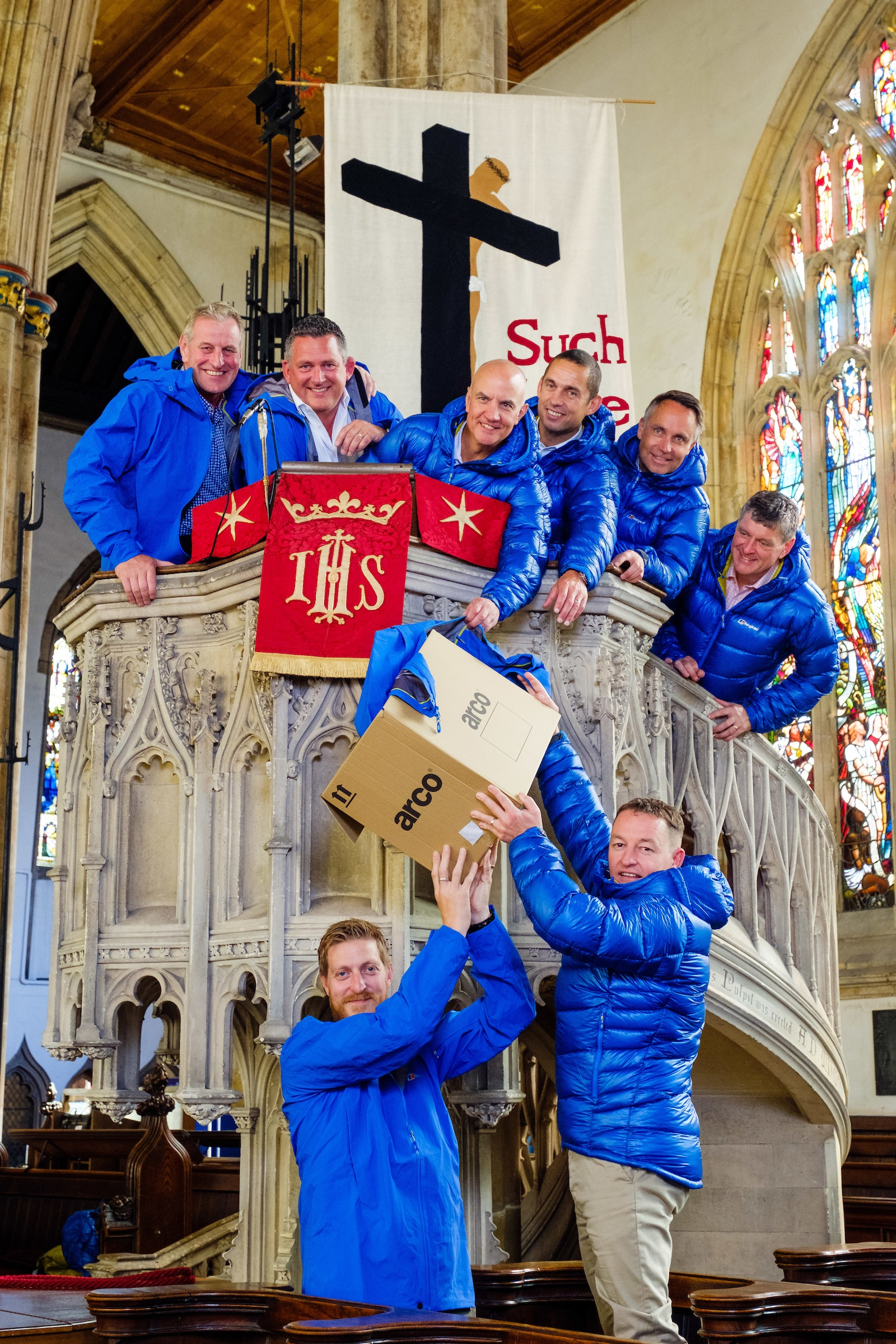 Andy Parkinson (Spencer Group), bottom left, and Neil Riseham (Arco) pass the donated clothing to Kilimanjaro team members, from left, Andy Allenby (Allenby Commercial), Nic Marshall (ResQ Outsource Solutions), Jonathan Leafe (Strawberry), Dave Garness (Garness Jones), Nick Ward (Alan Wood and Partners) and Brian Gilliland (Holy Trinity) in the pulpit at historic Holy Trinity Church