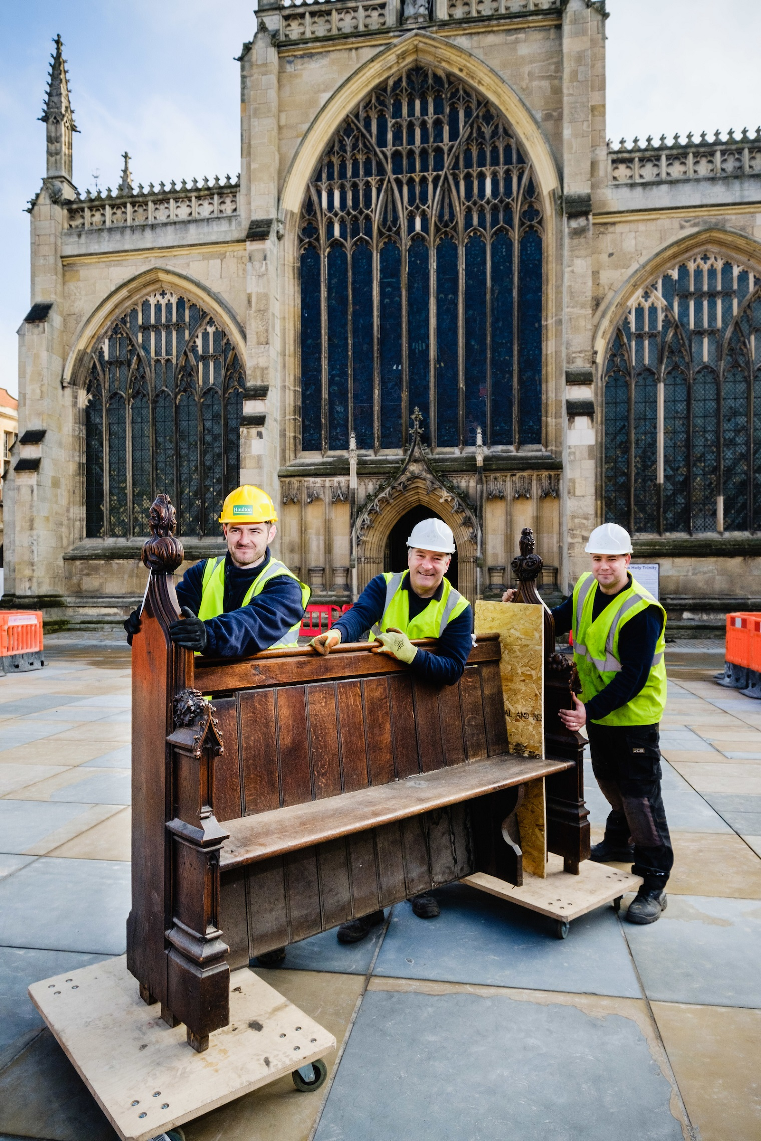 From left, workmen Mark Salter, Andrew Martindale and Andy Thompson remove the first pew as part of the internal transformation of Hull's historic Holy Trinity Church