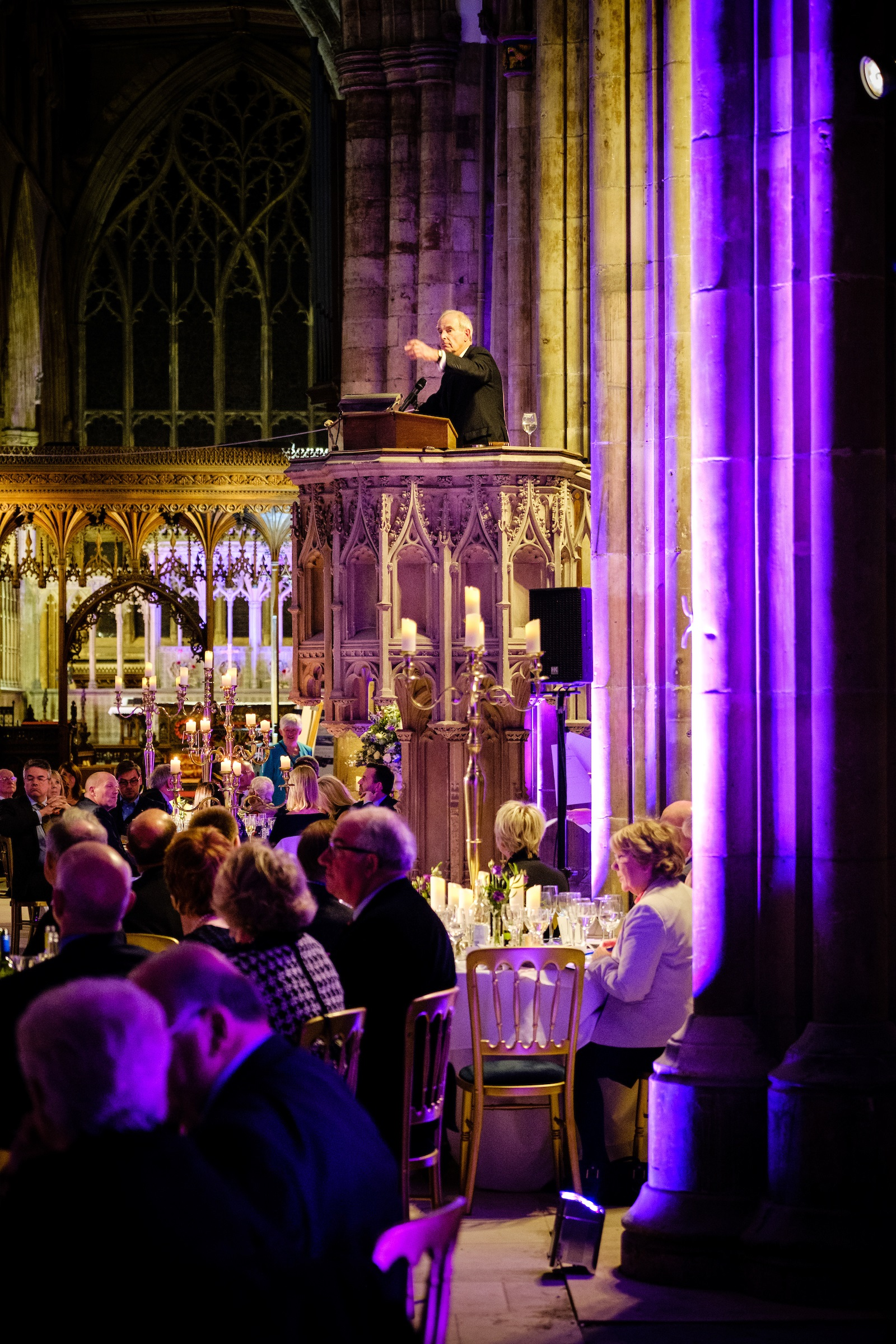 Auctioneer Stephen Larard encourages diners to support the auction of fantastic experiences from the pulpit at Hull Minster.