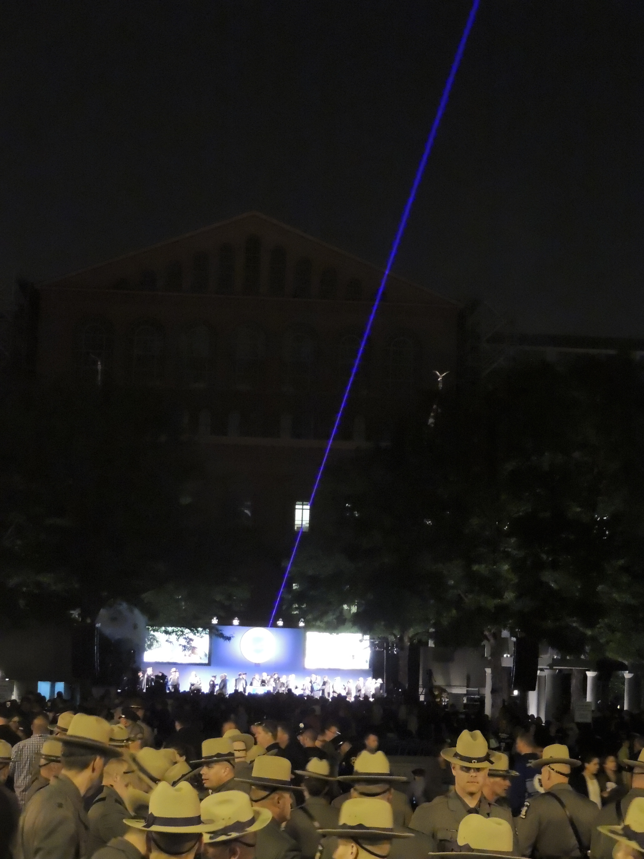 The thin blue line over the crowd at the candle light vigil.
