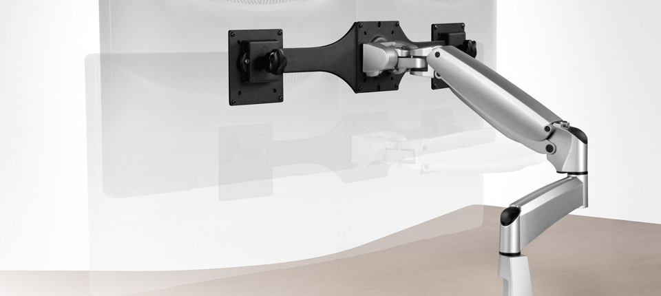 The Workrite Poise™ monitor arm features a parallel linkage design with adjustable pneumatic counter balance that floats the monitor above the work surface.
