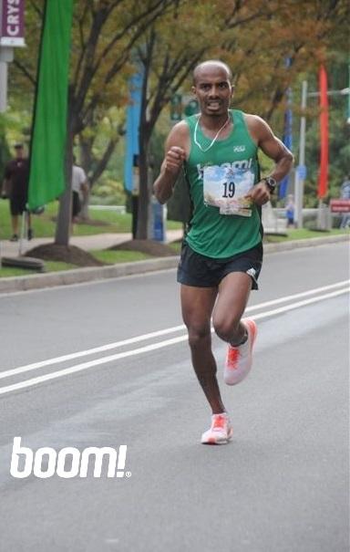 Desta on the way to 2nd OA finish at 2016 Marine Corps Marathon