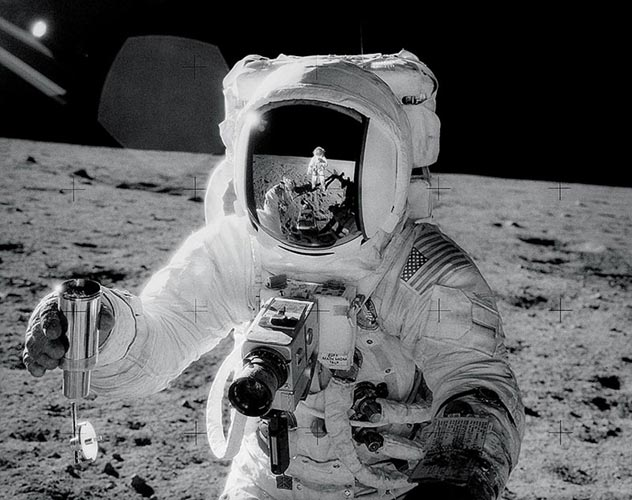 Buzz Aldrin shot by Neil Armstrong (who you can also see in the helmet reflection). Buzz is holding his Hasselblad and Neil is using one to take the photo