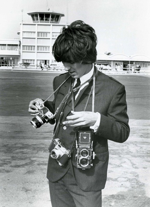 George Harrison with a Nikon F, Kodak Retina IIS and Rolleiflex cameras