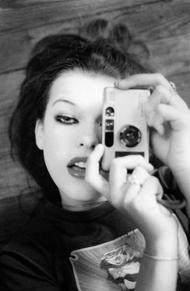 Milla Jovovich with Contax T2 camera