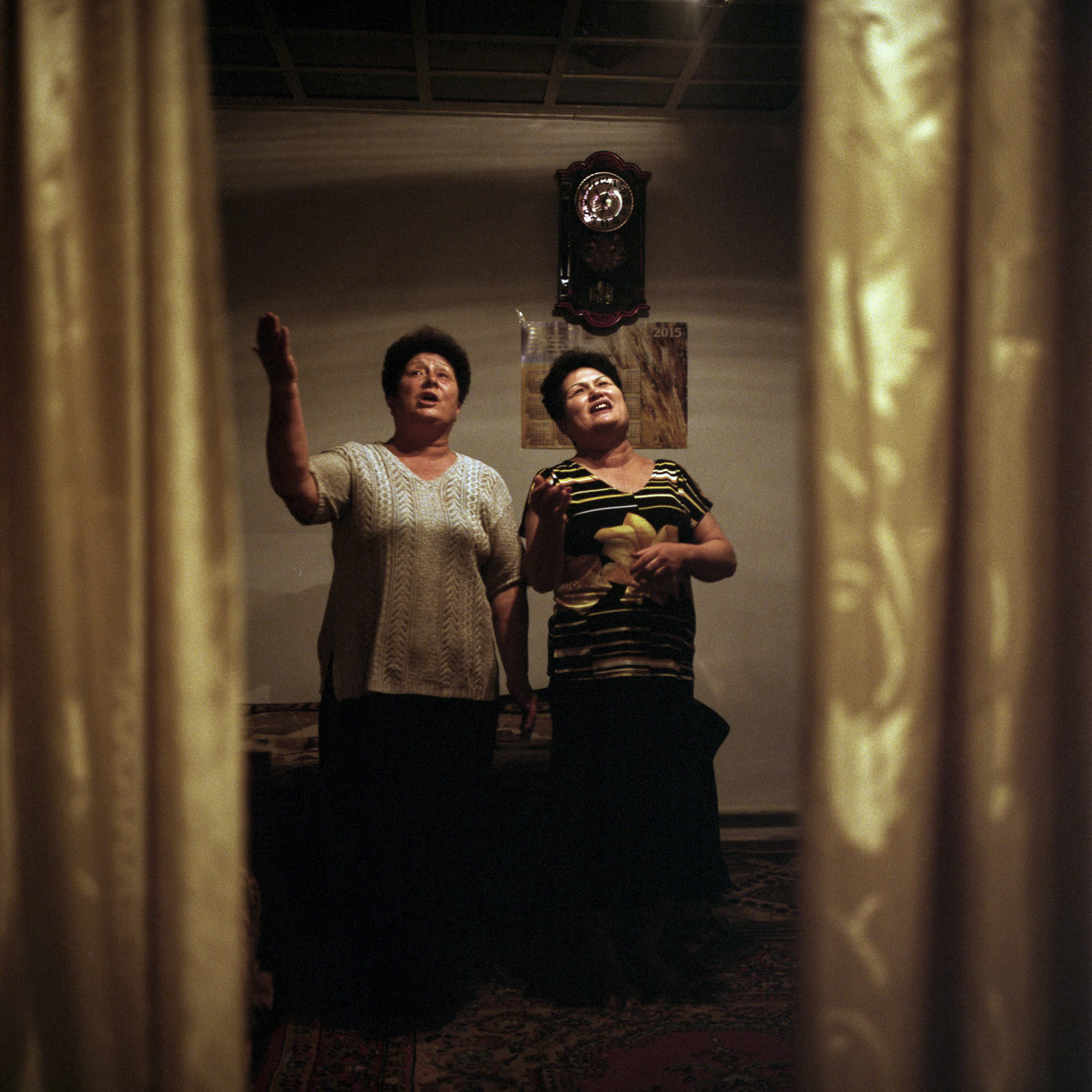 Sisters Anna and Aliona Kim, singing a Korean folk song. As a Korean living in the Russian Far East, their father was forcefully deported to Kazakhstan. Their mother was Russian thus free to stay, but unwilling to be separated from her husband, she decided to board the train with him. Eskeldy-bi, Kazakhstan. January 2015.