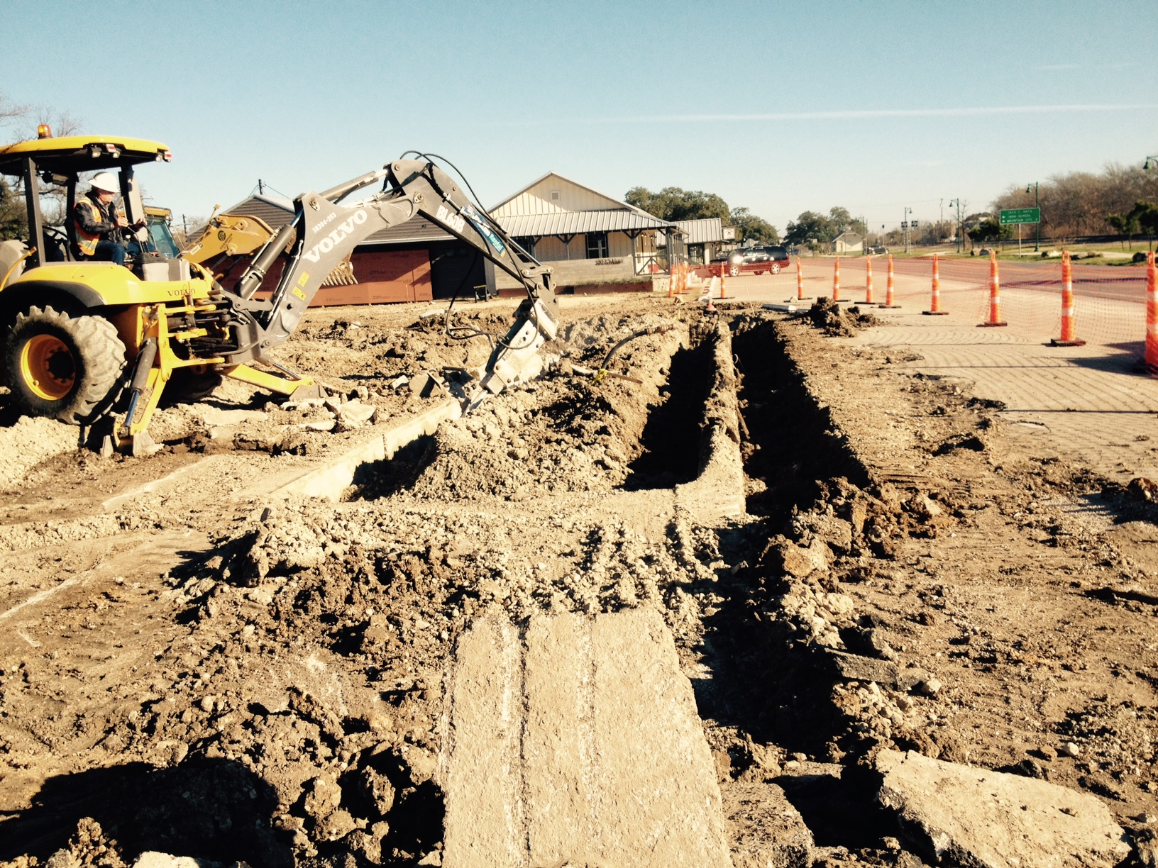 "The contractor had to work around the old scale concrete housing to install the 12"" water line."