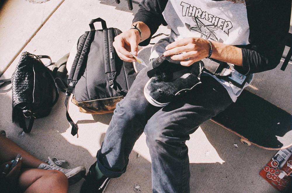 Mason Fixing His Shoes At The Skatepark