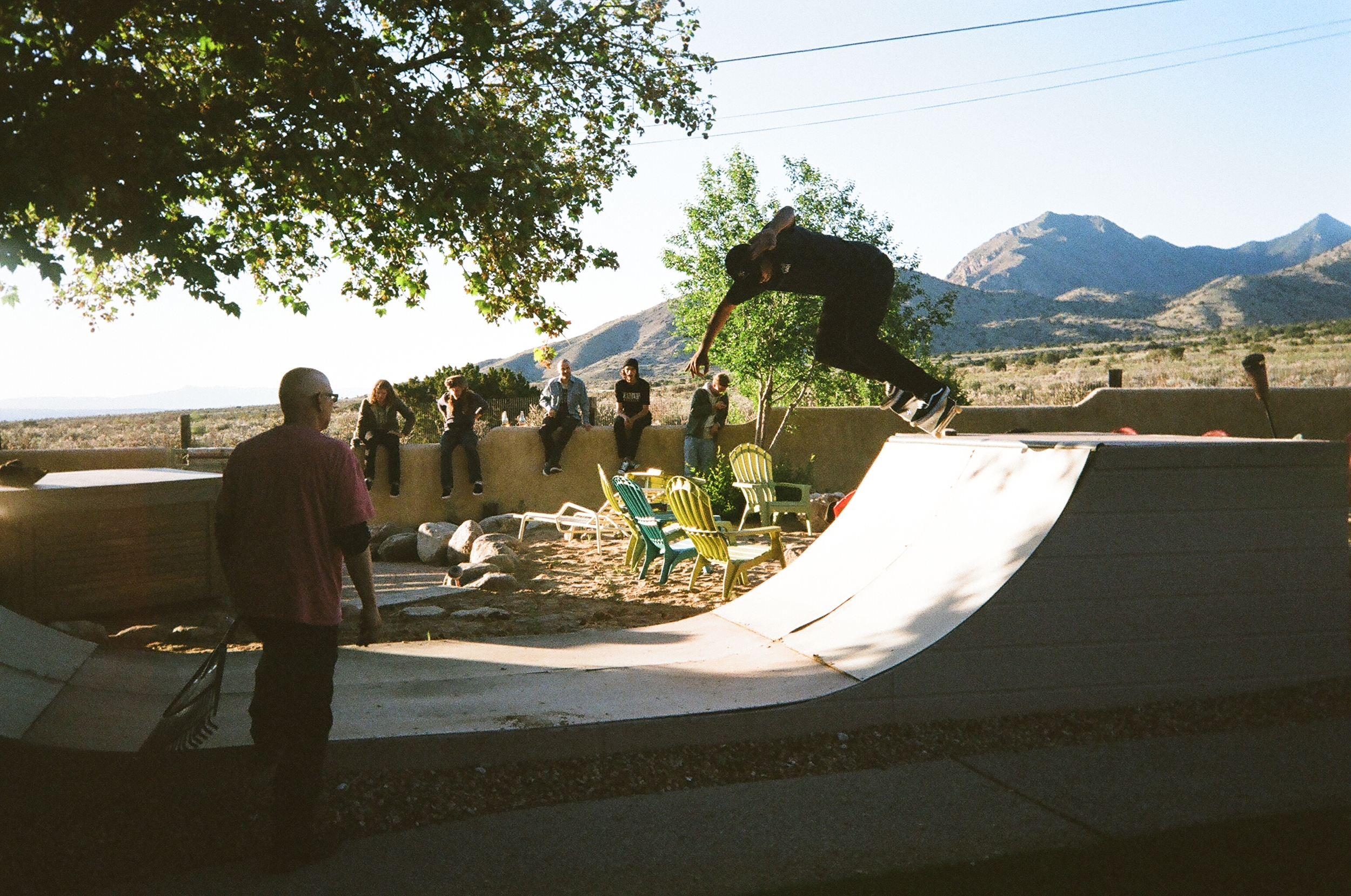 """Deathwish summer trip, folks back yard. my dad checking the scene most like coordinating a BBQ for the wall boys while JBone back d's our childhood ramp. Paradise."""