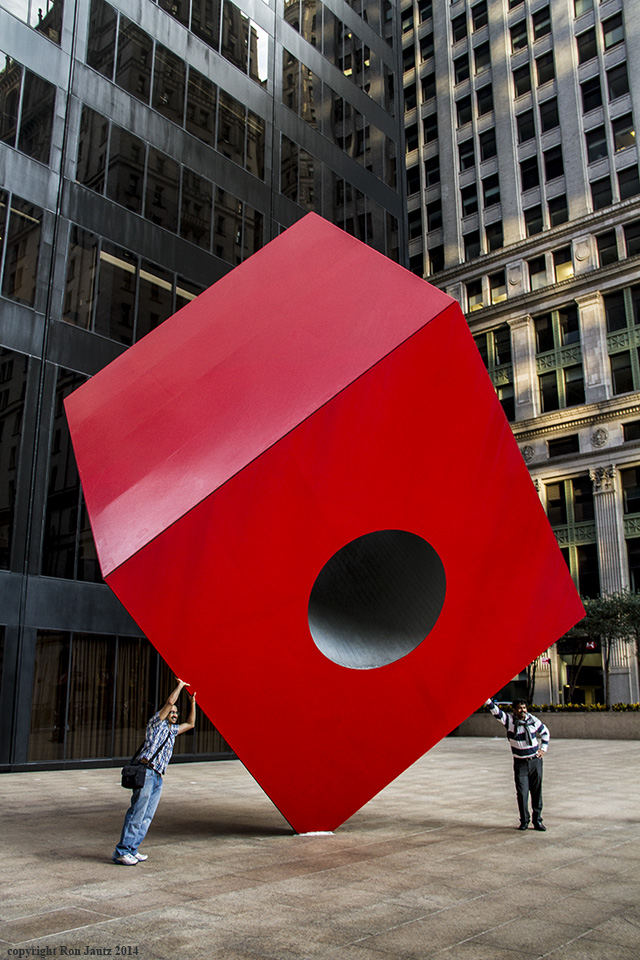 "The ""Red Cube"" is located on the plaza at 140 Broadway.  ISO 400, 1/60th sec. at f5.6, 20mm lens."