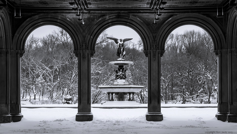 The Angel of the Waters statue of Bethesda Fountain through the arches of the terrace.                                                               ISO 400, 2.5 sec. f11, 62mm lens.