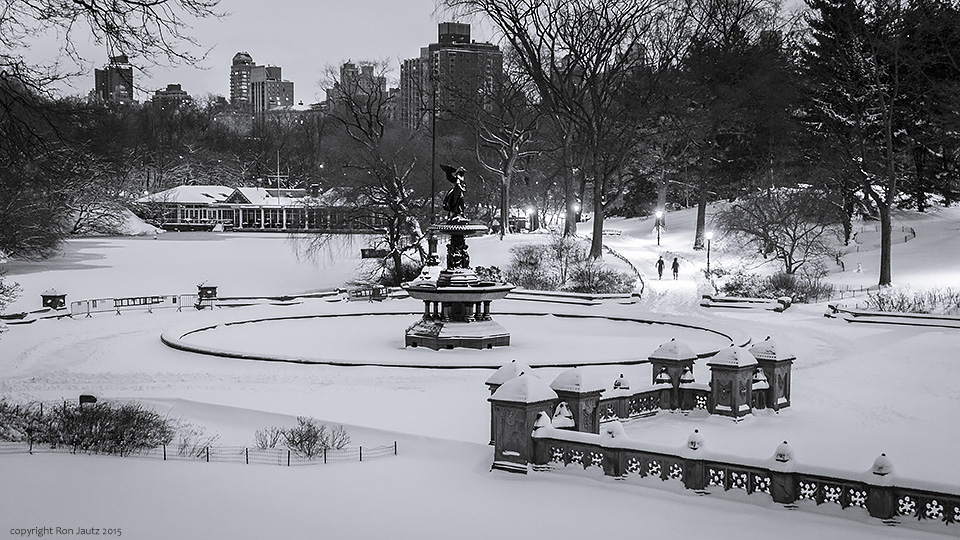 Two people trudge through the snow at Bethesda Terrace in Central Park.                ISO 400, 1 sec. f5.6, 24mm lens.