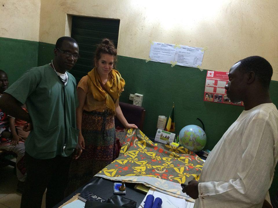 Dr. YssouffKone and Eliza take a look at the HPV Pagne with GAIA Mali Director, Dr. Karamoko Tounkara