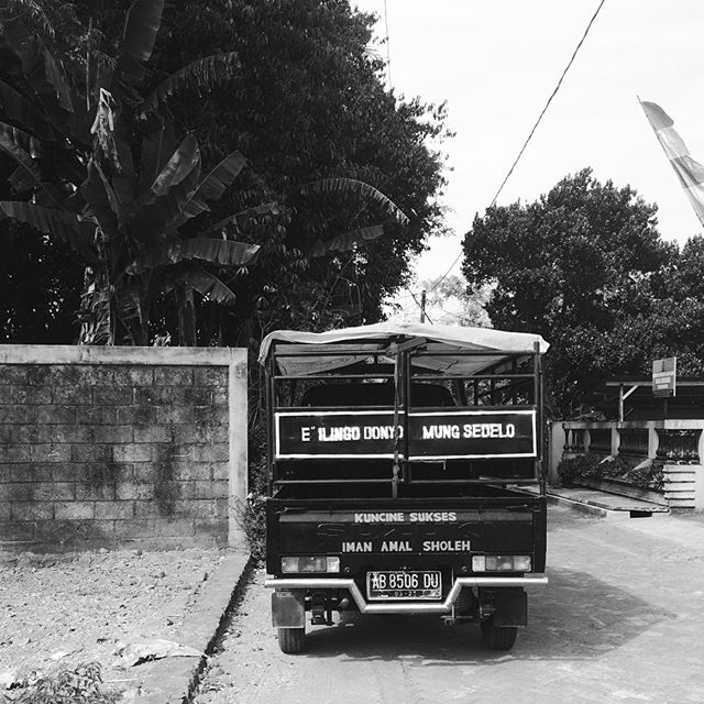 One of Indonesia's unique social features is the deep underlying logic of spirituality. In this picture, spirituality is displayed discursively on the back of the vehicle. It says: O remember, This world is only momentary. The keys to success, Faith and good deeds.