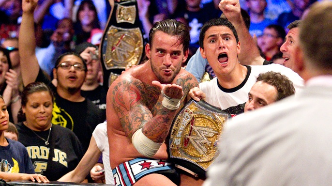 """CM Punk blows a kiss (of death) to WWE Owner, Vince McMahon, after securing an extended WWE contract, and winning the WWE Championship at the """"WWE Money In The Bank""""Pay Per View,in front of his hometown of Chicago, IL."""