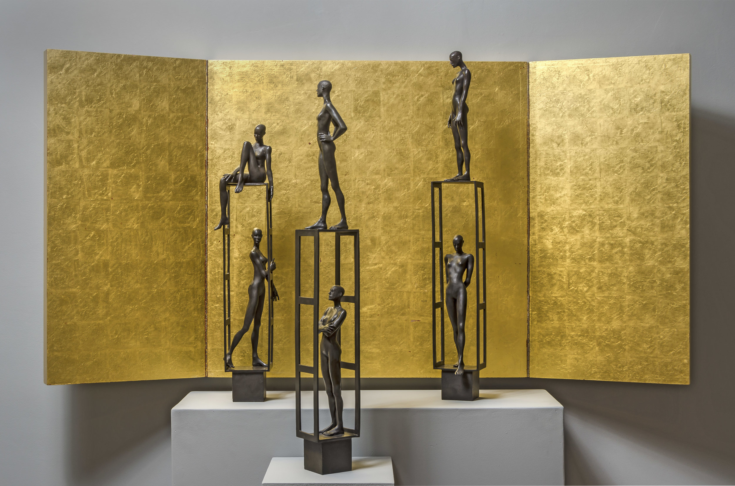 Estructura 1 ,  Estructura 2 , and  Estructura 3 , 2019 bronze in front of a wooden and gold leaf screen