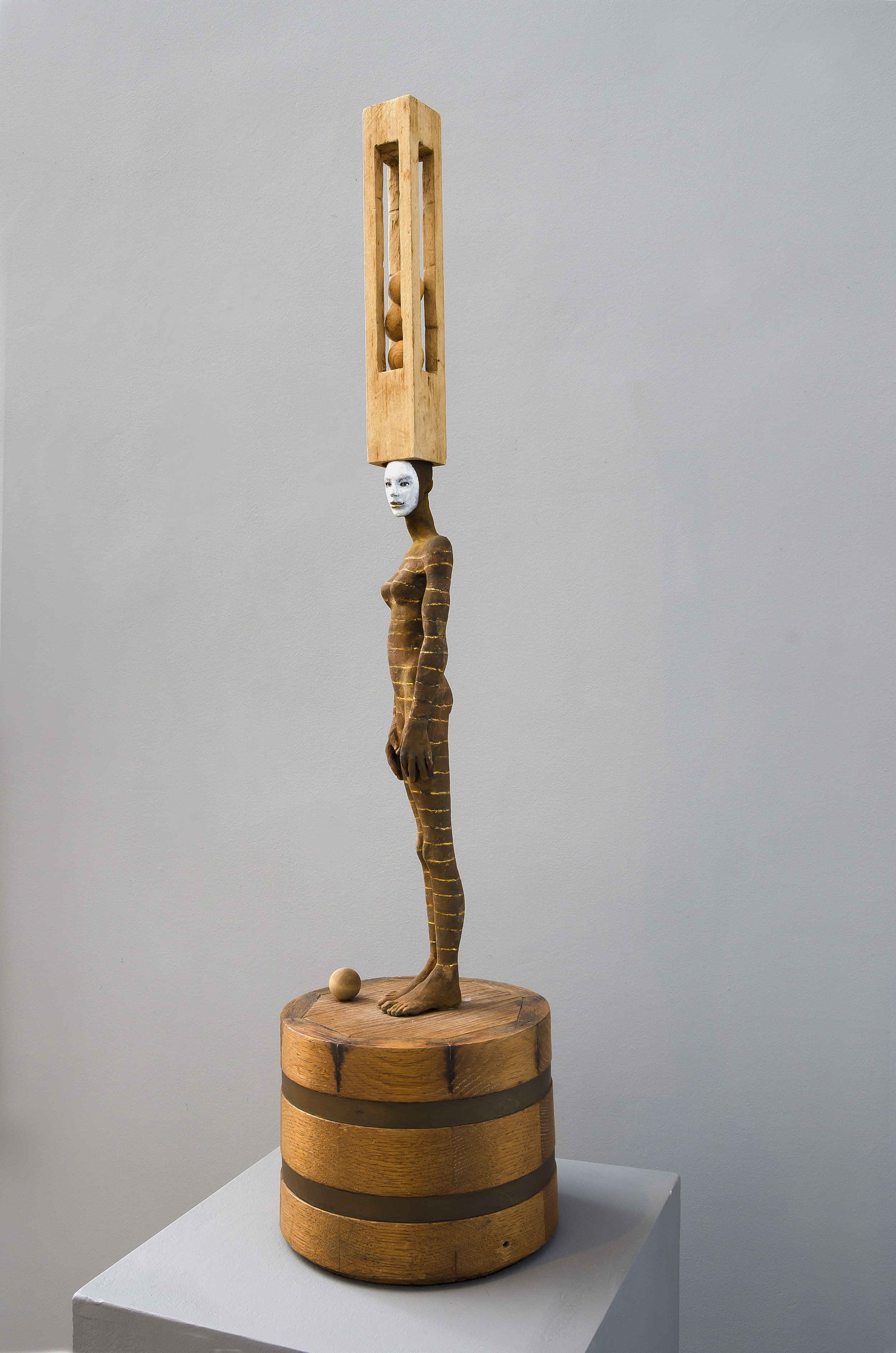Cecilia Z. Miguez (b. 1955)   Balancing Act , 2011  bronze and wood 34 x 8 1/2 x 8 1/2 inches; 86.4 x 21.6 x 21.6 centimeters