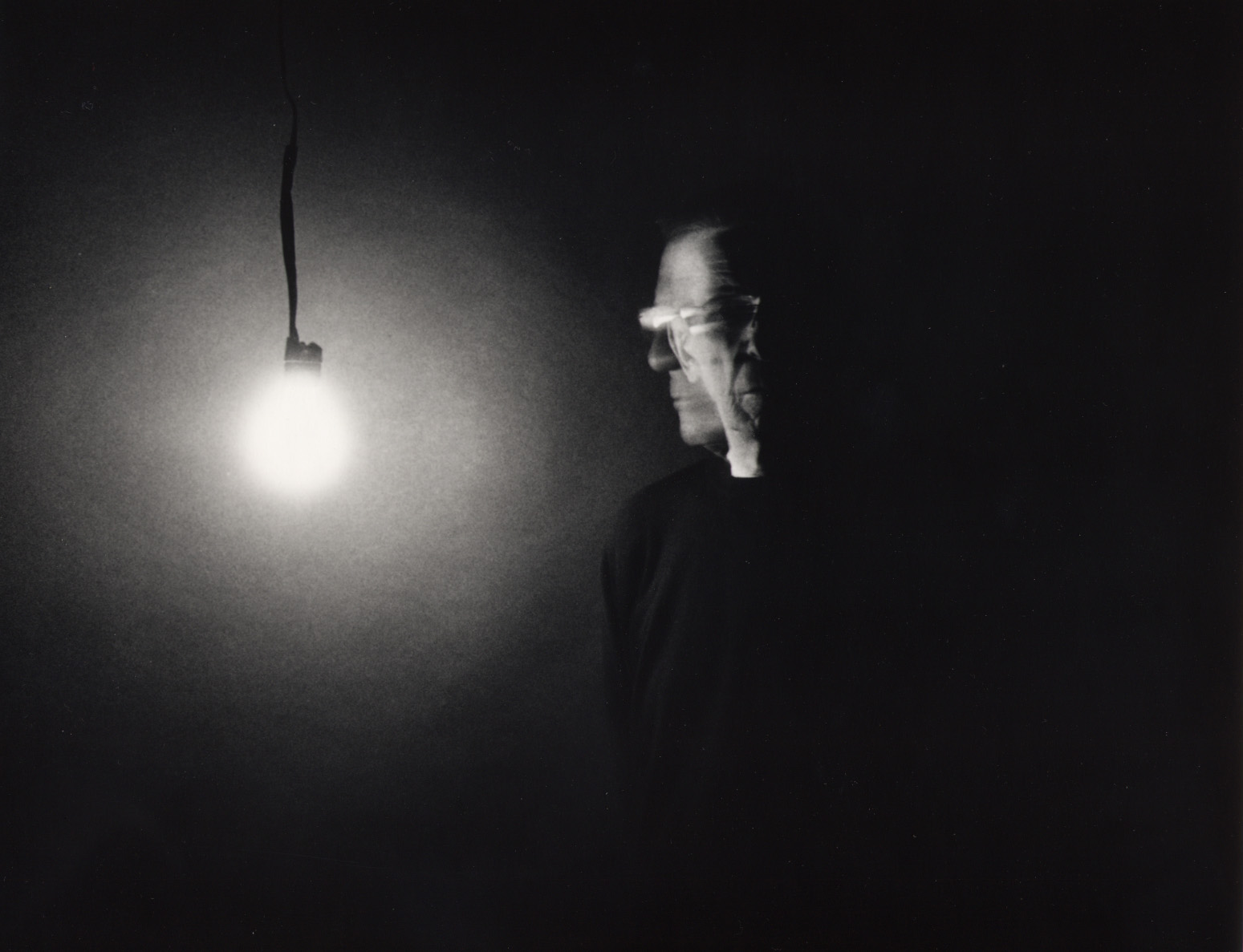 Self Portrait with Bulb , 2003 silver gelatin print 11 x 14 inches; 27.9 x 35.6 centimeters