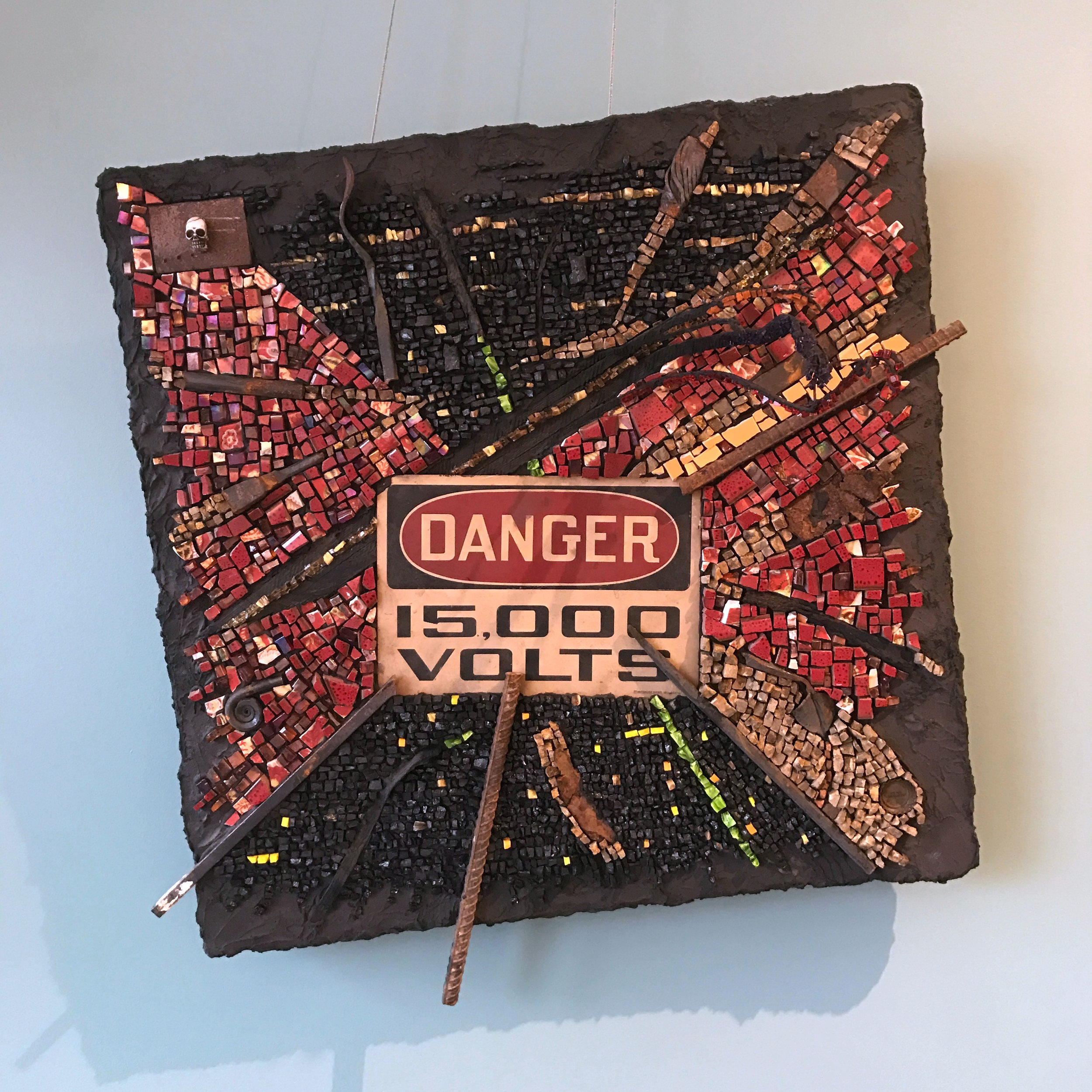 """""""Danger"""" 2015 Coal, anthracite, limestone, sandstone, porcelain, ceramic, molten glass, stained glass, smalti, steel shards, tire shards in thin-set mortar on hand-made substrate., 26""""w x 26""""h x 5""""d"""