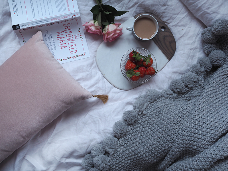 Pink cushion , £19.50;  Grey pom pom throw , £69;  Serving board , £25 all Marks and Spencer