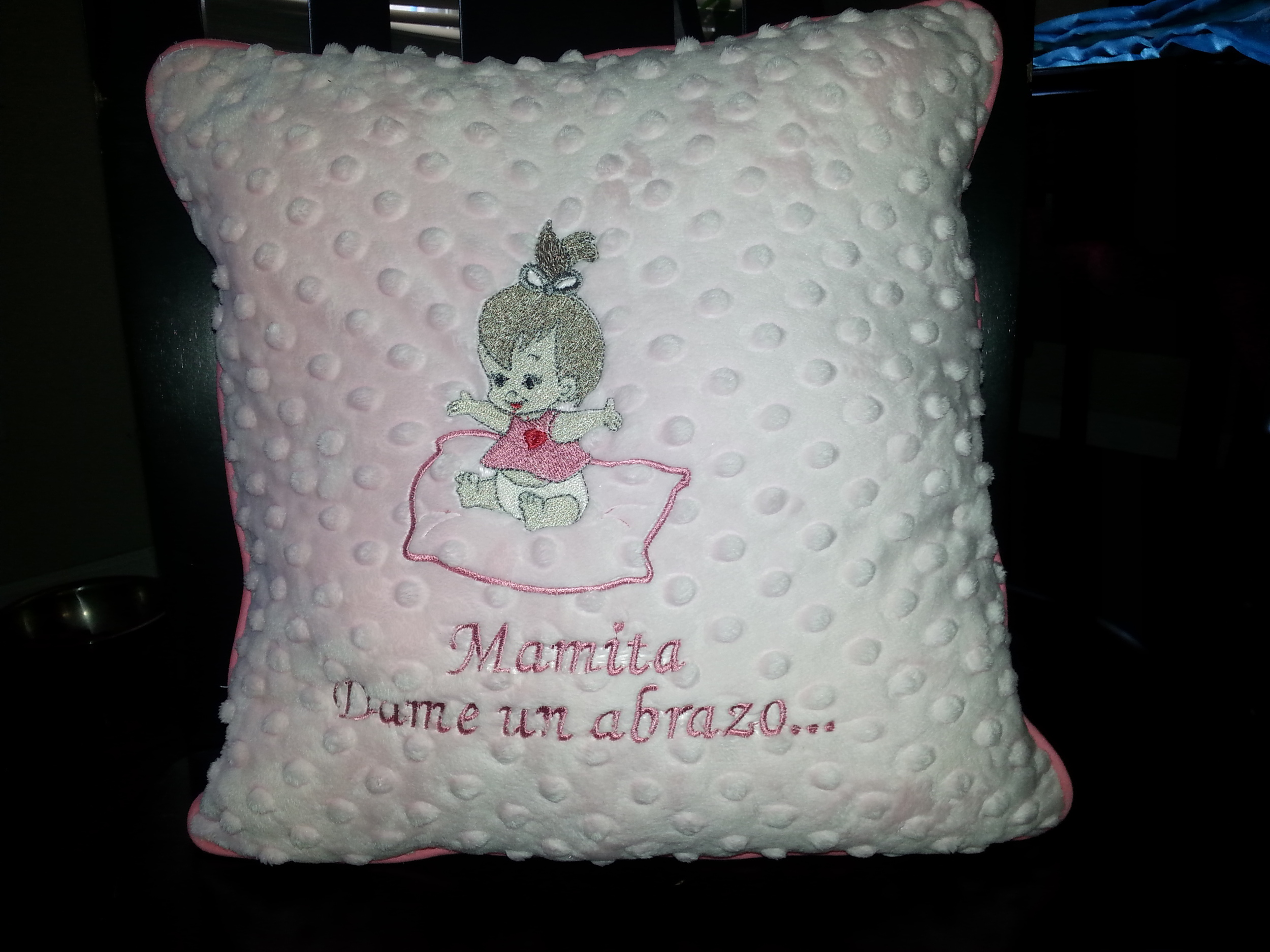 Baby deco pillow on pink.