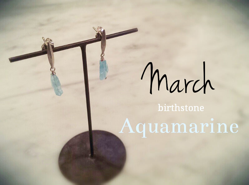 March-Aquamarine  March's birthstone is the serene aquamarine, a soothing gemstone that ranges in color from sea green to sky blue. We think it's quite fitting that its name comes from the Latin words for water (aqua) and sea (marinus)! The gentle color of the aquamarine is said to keep the wearer's mind calm and balanced. Even though it's well-known, some people categorize aquamarine as unexciting and cheap, but this is far from accurate. It comes from the Beryl family, which makes it a cousin of the emerald. In fact, emerald refers to green beryl while aquamarine is blue beryl. Did you know the majority of the aquamarines found today are mined in Brazil? Our earrings from Geometric series feature a stunning hand-cut aquamarine from Brazil, and are perfect for complimenting your spring and summer wardrobe!