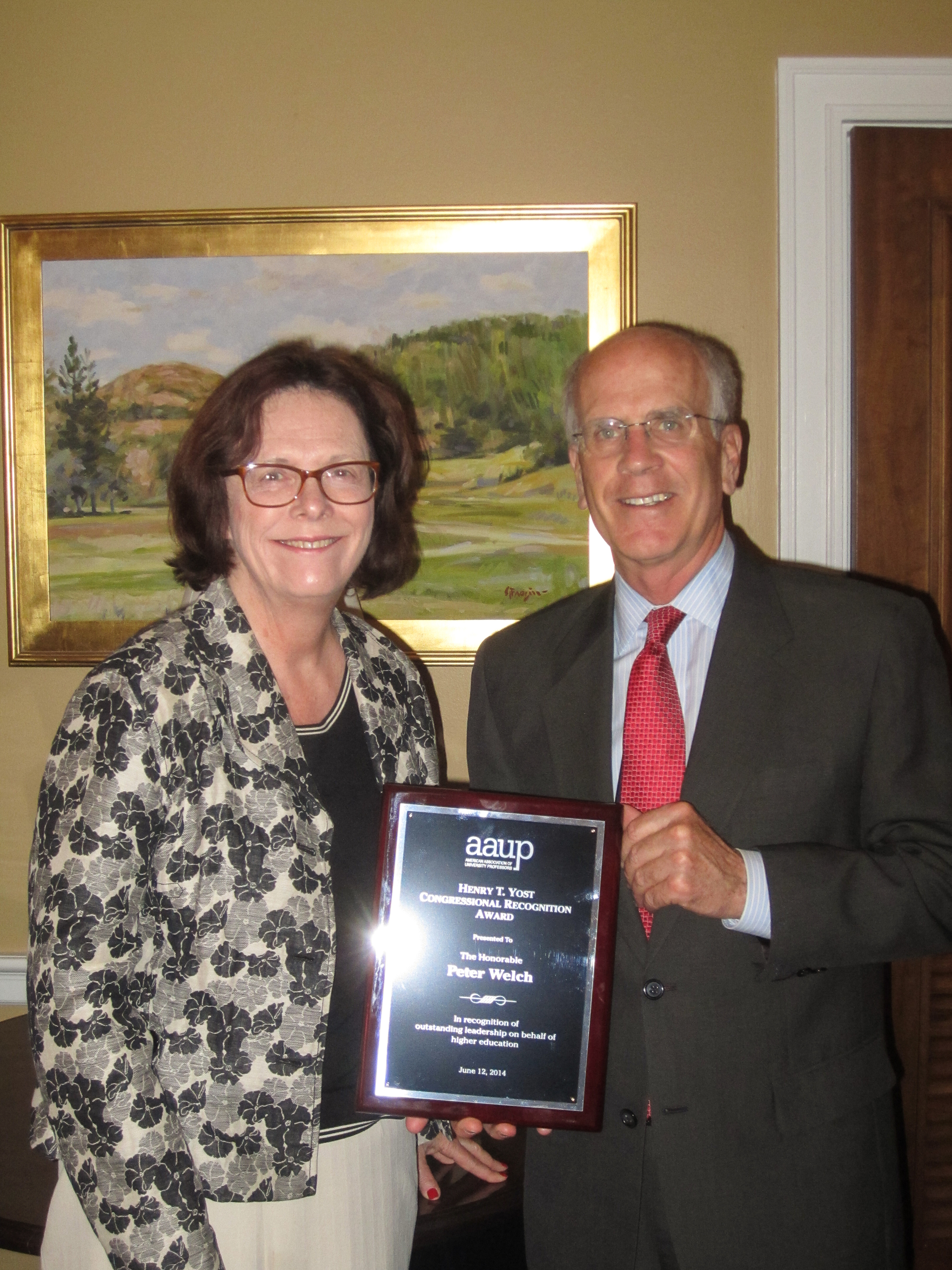 UA President Denise Youngblood presents the AAUP's Henry T. Yost Award to Congressman Peter Welch (D-VT)