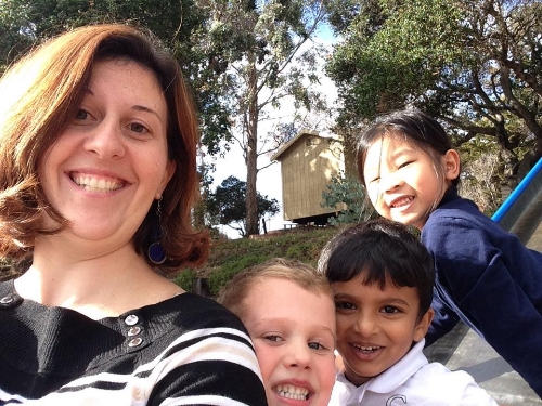 Miss Marquardt and some kindergartners being silly at recess.