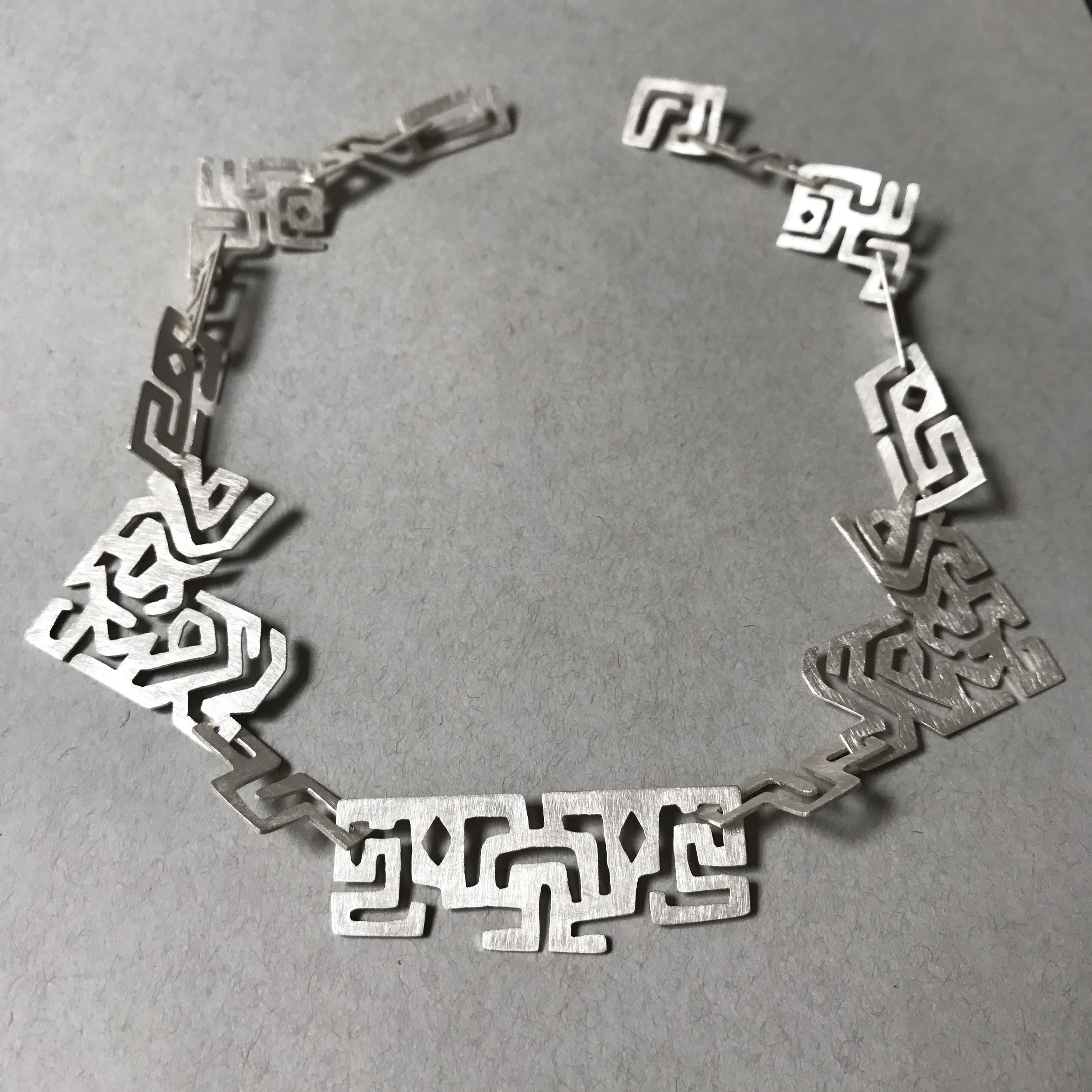 "Maze - Sterling Silver, 2016We are born into this maze called life, and begin to move around, driven by the necessity to survive and the desire to explore. Along the way we take wrong turns, hit dead ends and almost always end up in unexpected places.I believe a heightened awareness of our journey is what allows us to have appreciation and wisdom. With a sense of enlightenment we are able to realize that in the end, all those ""wrong turns"" were actually simply parts of the puzzle that comprise a beautiful life story."