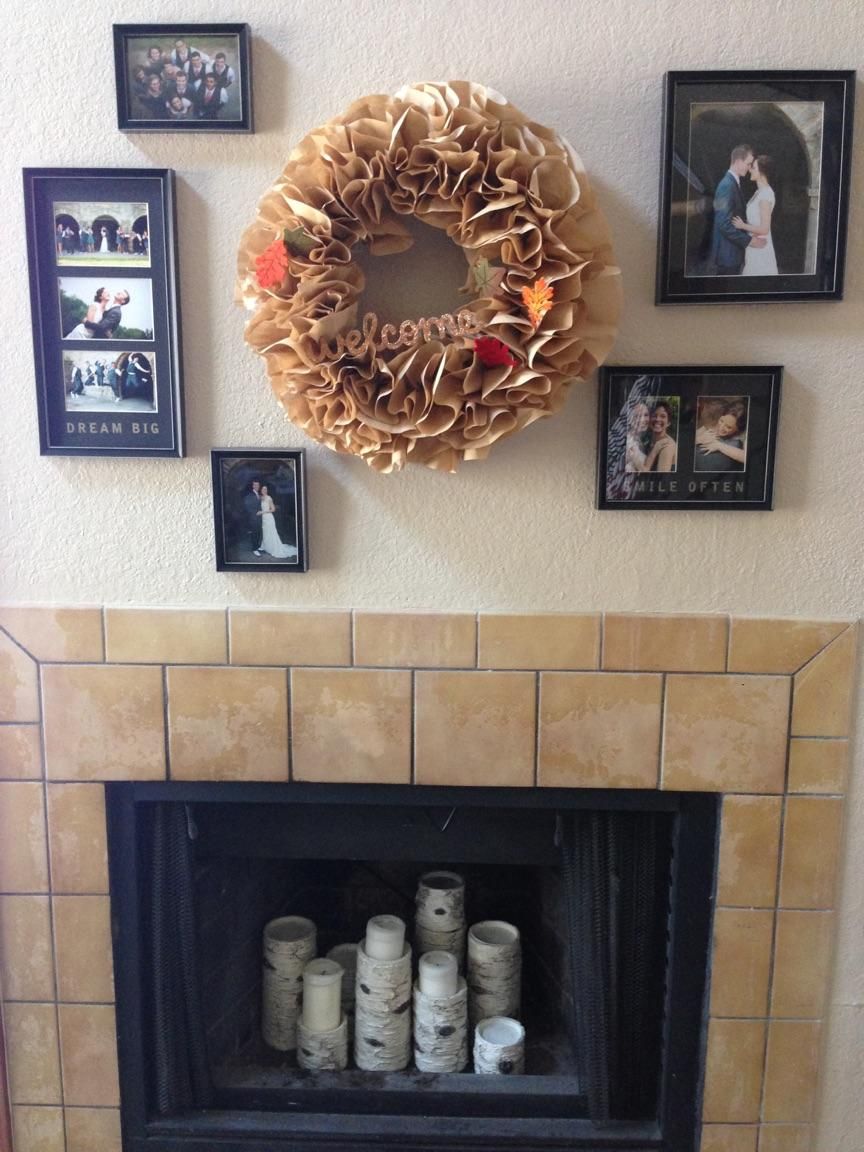 Photos on wall above fireplace