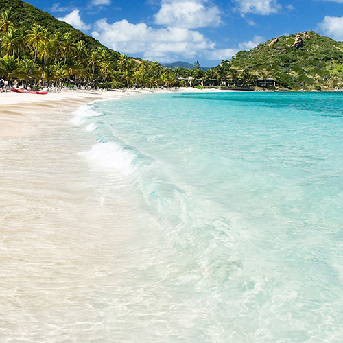 """Peter Island  is a 720 hectare (1,779 acre)  [1]  private island located in the   British Virgin Islands  (BVI). It is about 5.2 miles [  vague  ] south-west (195 degrees true) from Road Harbour (Road Town),  Tortola  . The island was named after   Pieter Adriensen  (nicknamed """"The Commander"""") who was the brother of   Abraham Adriensen  , Patron of Tortola under the   Dutch West India Company  in the early 17th century. Pieter Adriensen and   Joost van Dyk  built a  fort  and slave pens at   Great Harbour  on Peter Island to facilitate   privateering  and the nascent trade in   slaves  from   Angola  ."""