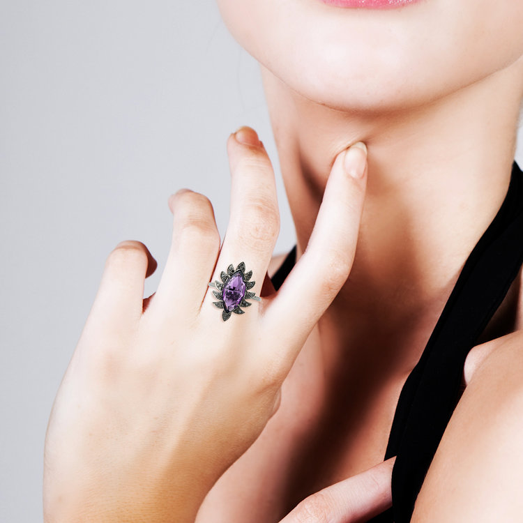 Exude elegance confidently with this claw marquise black onyx and diamond ring.