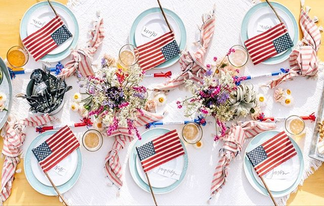 @beijosevents with @potterybarn came up with this great back yard 4th of a July party! you'll have to see all the cuteness on Beijos blog!  What are your 4th of July plans? . / Cheese Board by @graes_platters / Pie by @frostyourcookie / Placecards by @meghannminiello / Clothing by @chaserbrand & @chaserkids / Beer from @gunwhaleales / Champagne from @onehope