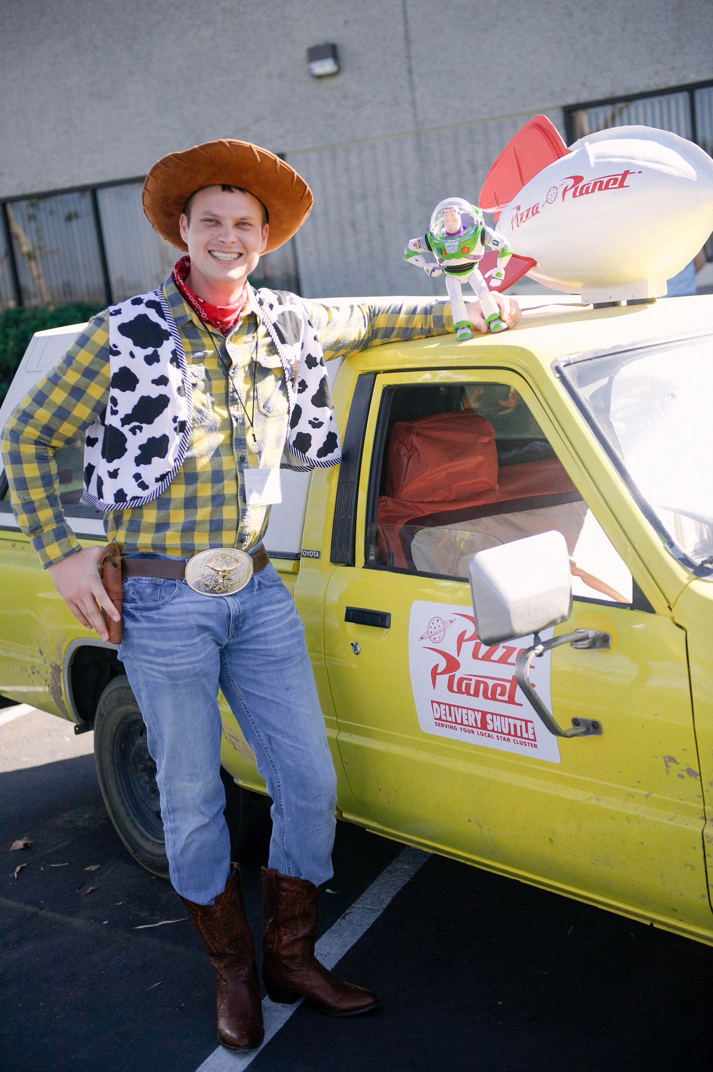 Brandon Spaulding as Toy Story's Woody with The Pizza Planet Truck. Photo by Lisa Diaz.