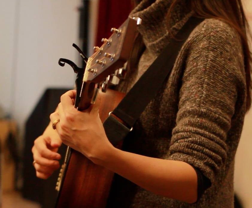 Emily playing guitar